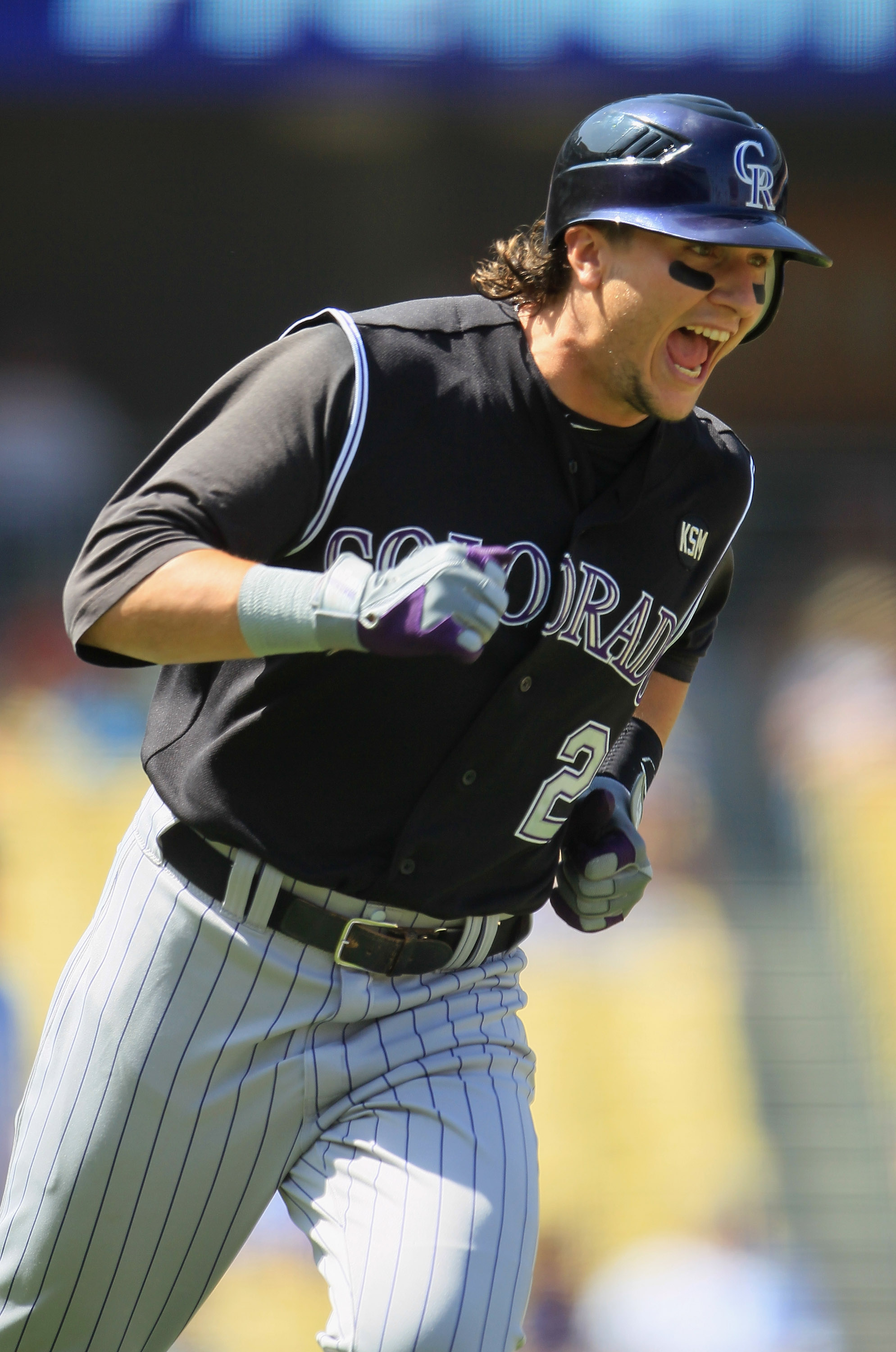 LOS ANGELES, CA - SEPTEMBER 18:  Troy Tulowitzki #2 of the Colorado Rockies celebrates as he rounds first base after hitting a two-run home run against the Los Angeles Dodgers in the first inning at Dodger Stadium on September 18, 2010 in Los Angeles, Cal