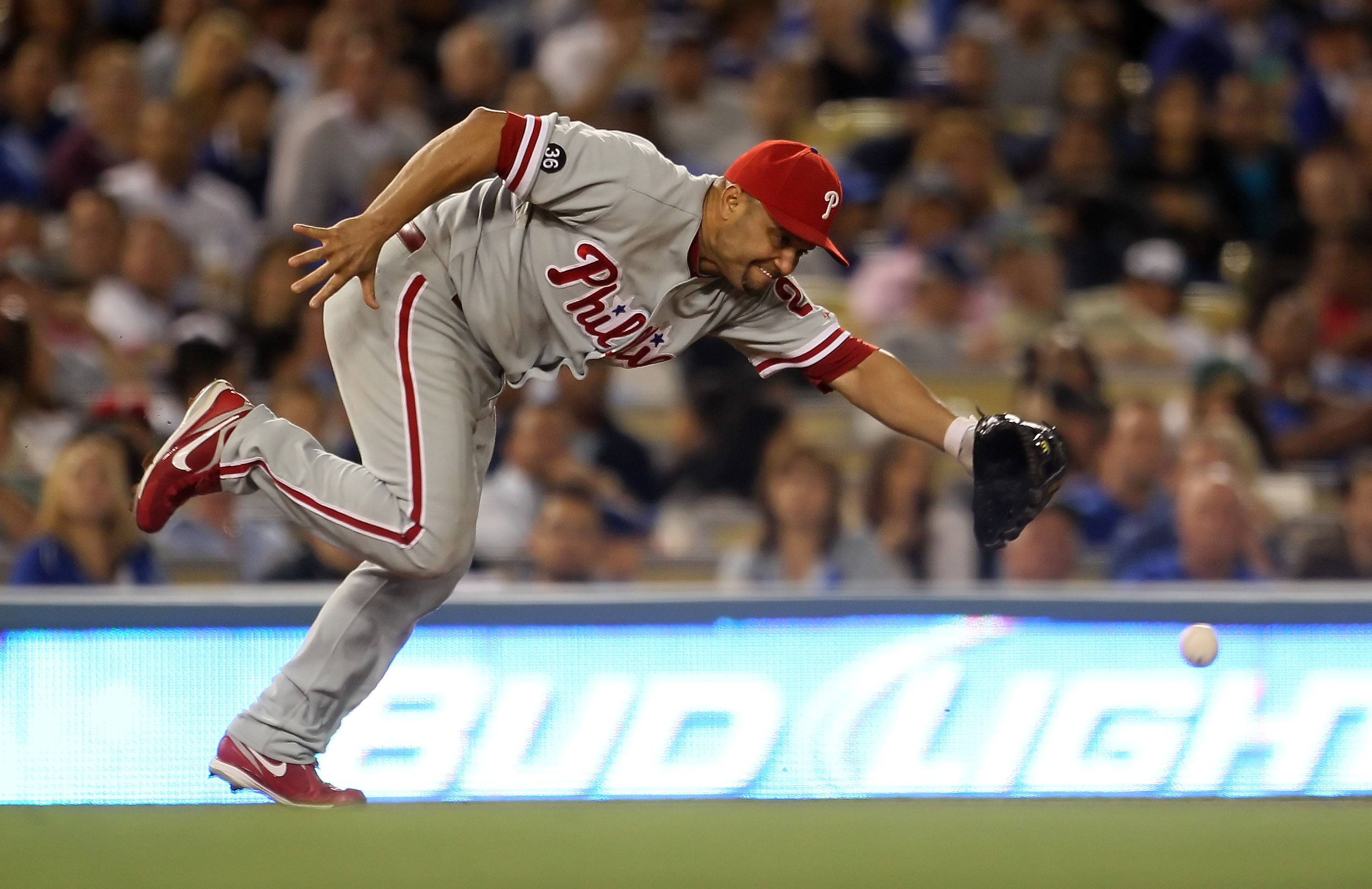 LOS ANGELES, CA - AUGUST 31:  Third baseman Placido Polanco #27 of the Philadelphia Phillies lunges for a ball hit by Rod Barajas of the Los Angeles Dodgers in the fifth inning at Dodger Stadium on August 31, 2010 in Los Angeles, California. The Phillies