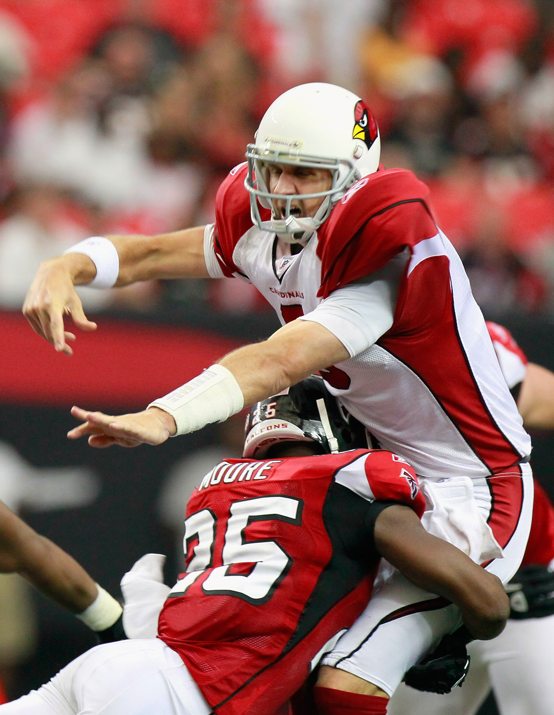 ATLANTA - SEPTEMBER 19:  William Moore #25 of the Atlanta Falcons tackles quarterback Derek Anderson #3 of the Arizona Cardinals at Georgia Dome on September 19, 2010 in Atlanta, Georgia.  (Photo by Kevin C. Cox/Getty Images)