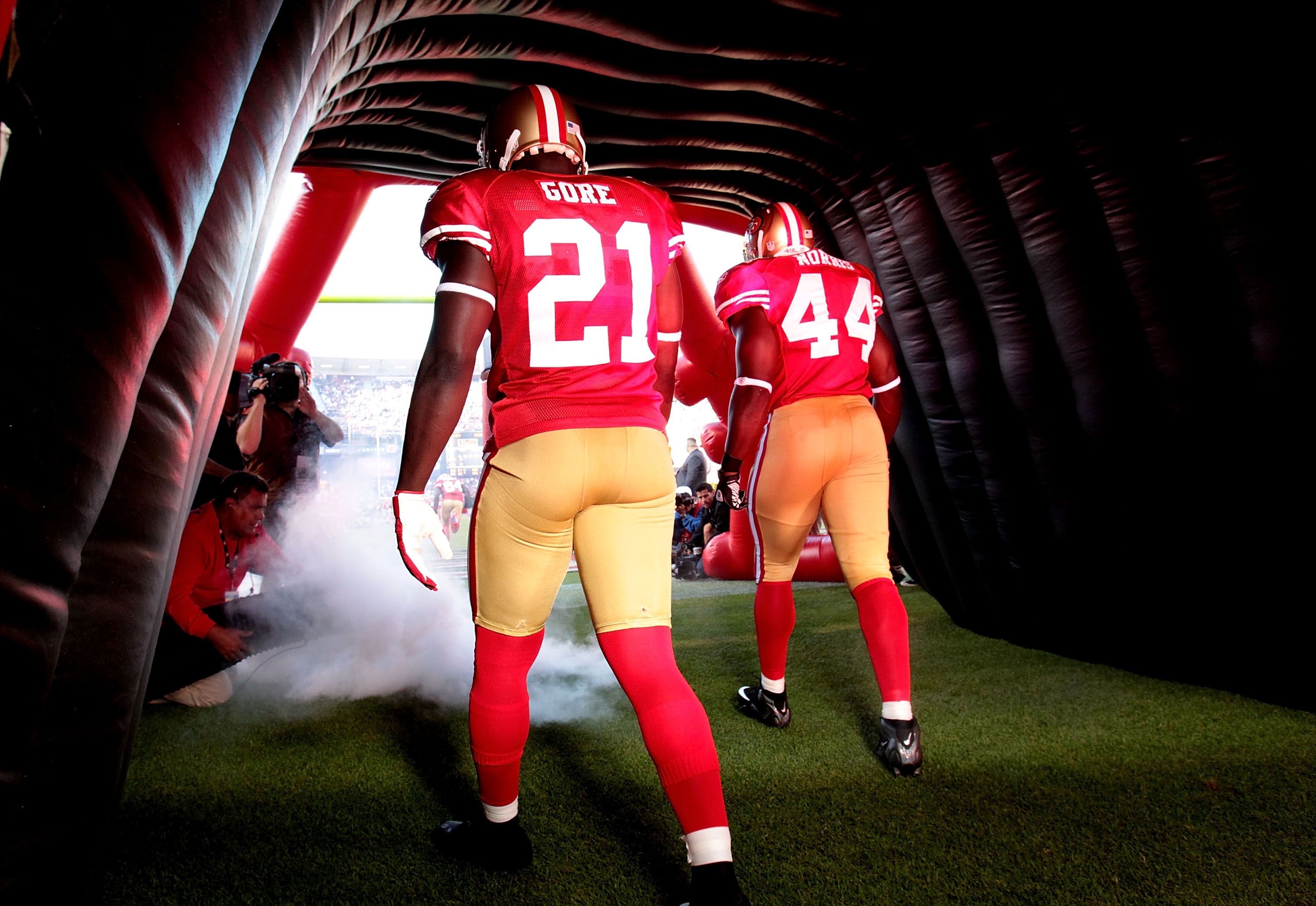 SAN FRANCISCO - SEPTEMBER 20:  Frank Gore #21 of the San Francisco 49ers is introduced against the New Orleans Saints during an NFL game at Candlestick Park on September 20, 2010 in San Francisco, California.  (Photo by Jed Jacobsohn/Getty Images)