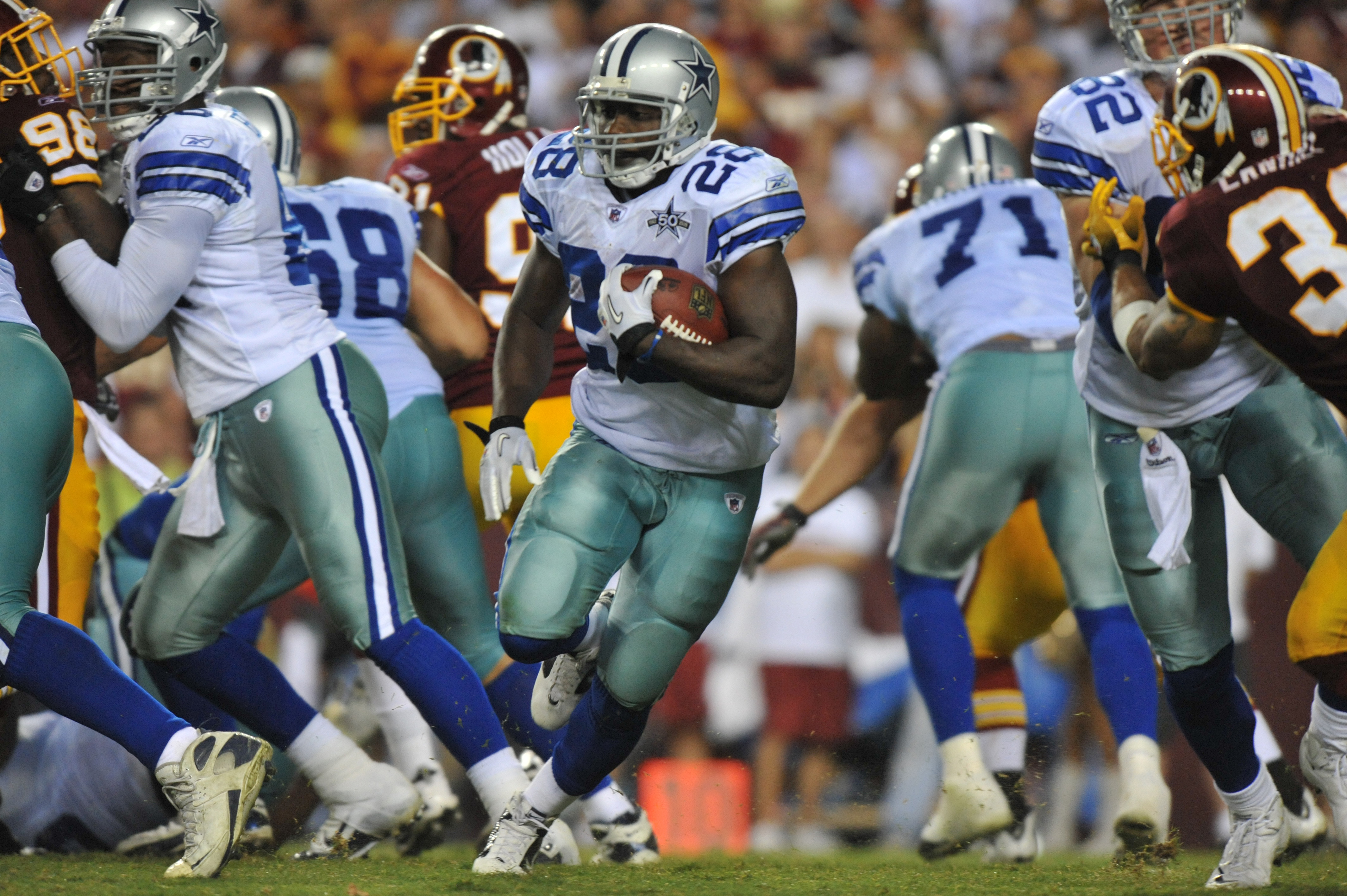 LANDOVER - SEPTEMBER 12:  Felix Jones #28 of the Dallas Cowboys runs the ball during the NFL season opener against the Washington Redskins at FedExField on September 12, 2010 in Landover, Maryland. The Redskins defeated the Cowboys 13-7. (Photo by Larry F