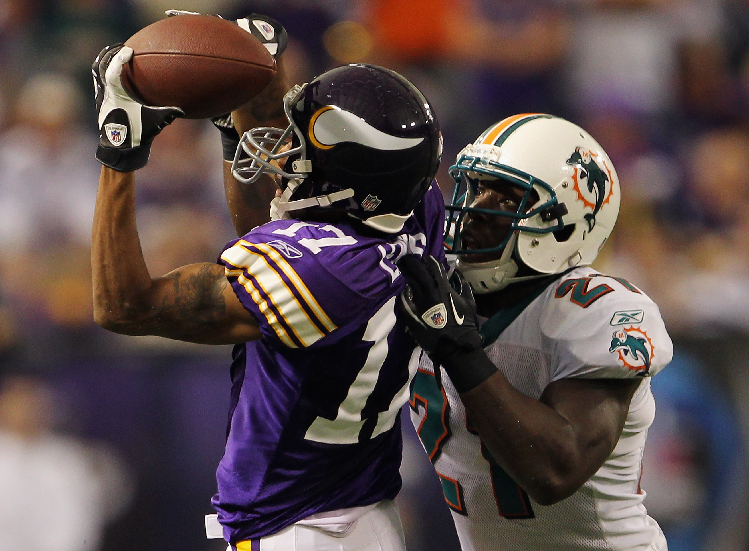 MINNEAPOLIS - SEPTEMBER 19:  Vontae Davis #21 of the Miami Dolphins breaks up a pass intended for Greg Lewis #17 of the Minnesota Vikings during the game on September 19, 2010 at Hubert H. Humphrey Metrodome in Minneapolis, Minnesota.  (Photo by Jamie Squ