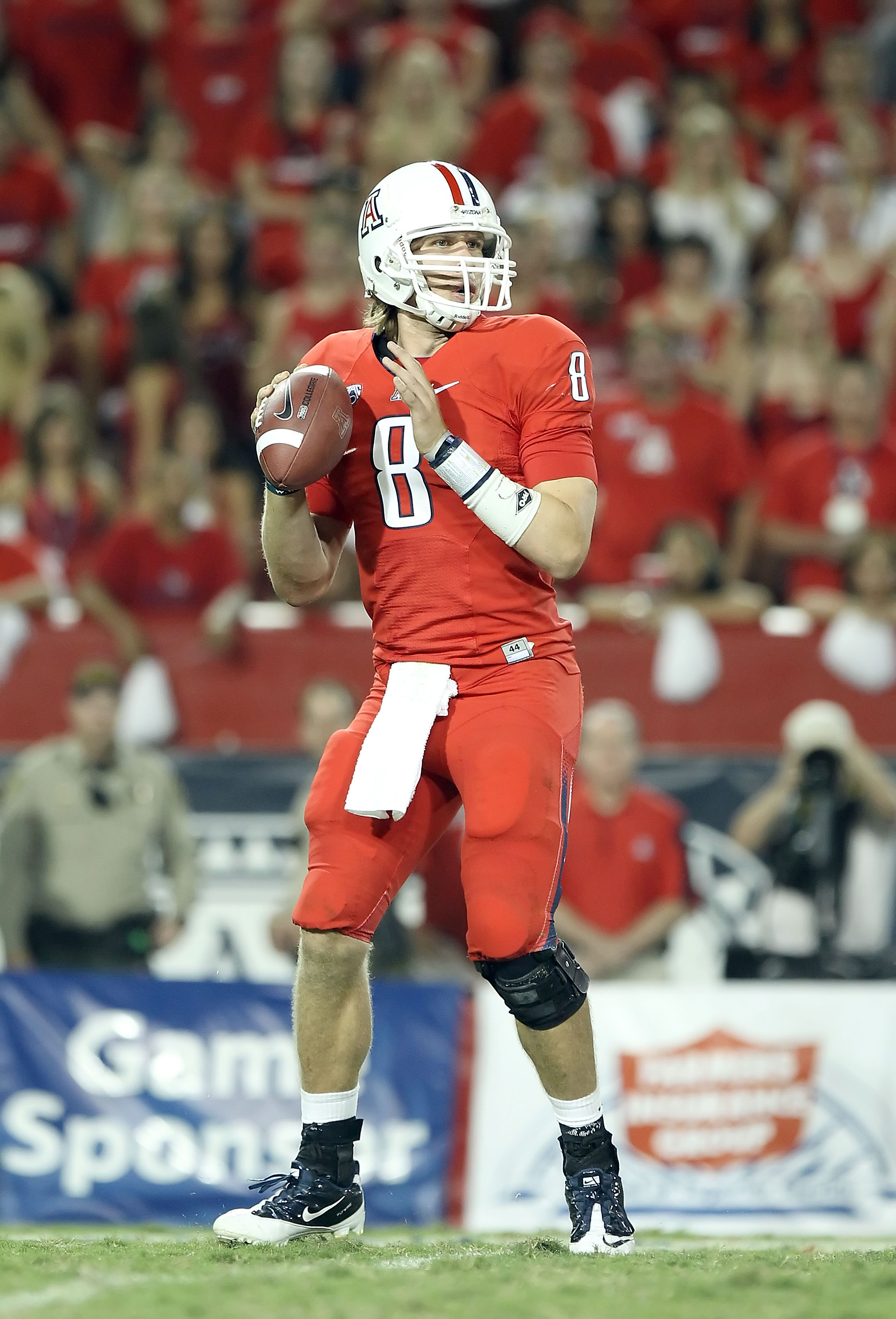 TUCSON, AZ - SEPTEMBER 18:  Quarterback Nick Foles #8 of the Arizona Wildcats drops back to pass during the college football game against the Iowa Hawkeyes at Arizona Stadium on September 18, 2010 in Tucson, Arizona. The Wildcats defeated the Hawkeyes 34-