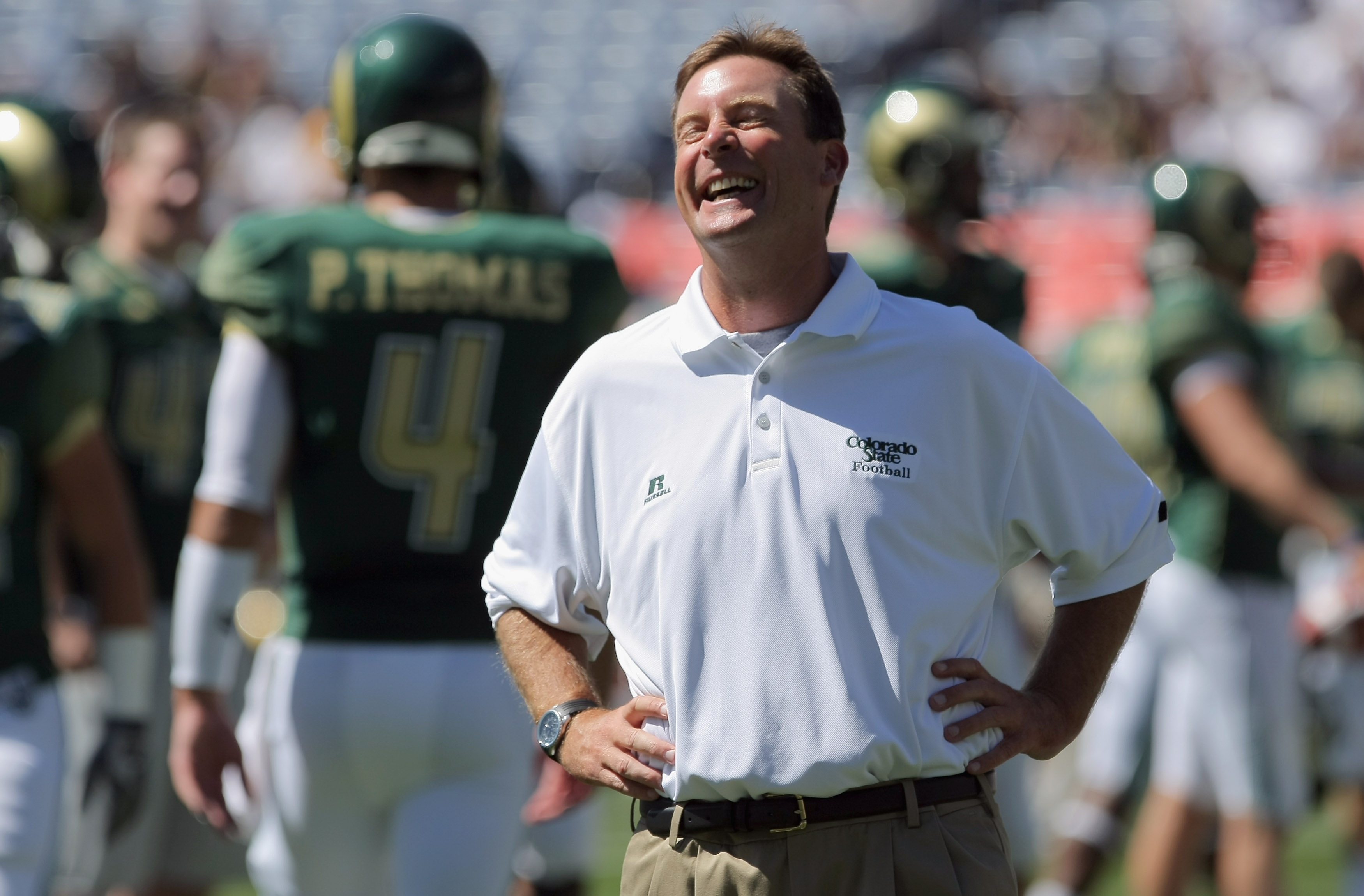 DENVER - SEPTEMBER 04:  Head coach Steve Fairchild of the Colorado State Rams reacts after talking to quarterback Pete Thomas #4 as they face the Colorado Buffaloes in the Rocky Mountain Showdown at INVESCO Field at Mile High on September 4, 2010 in Denve
