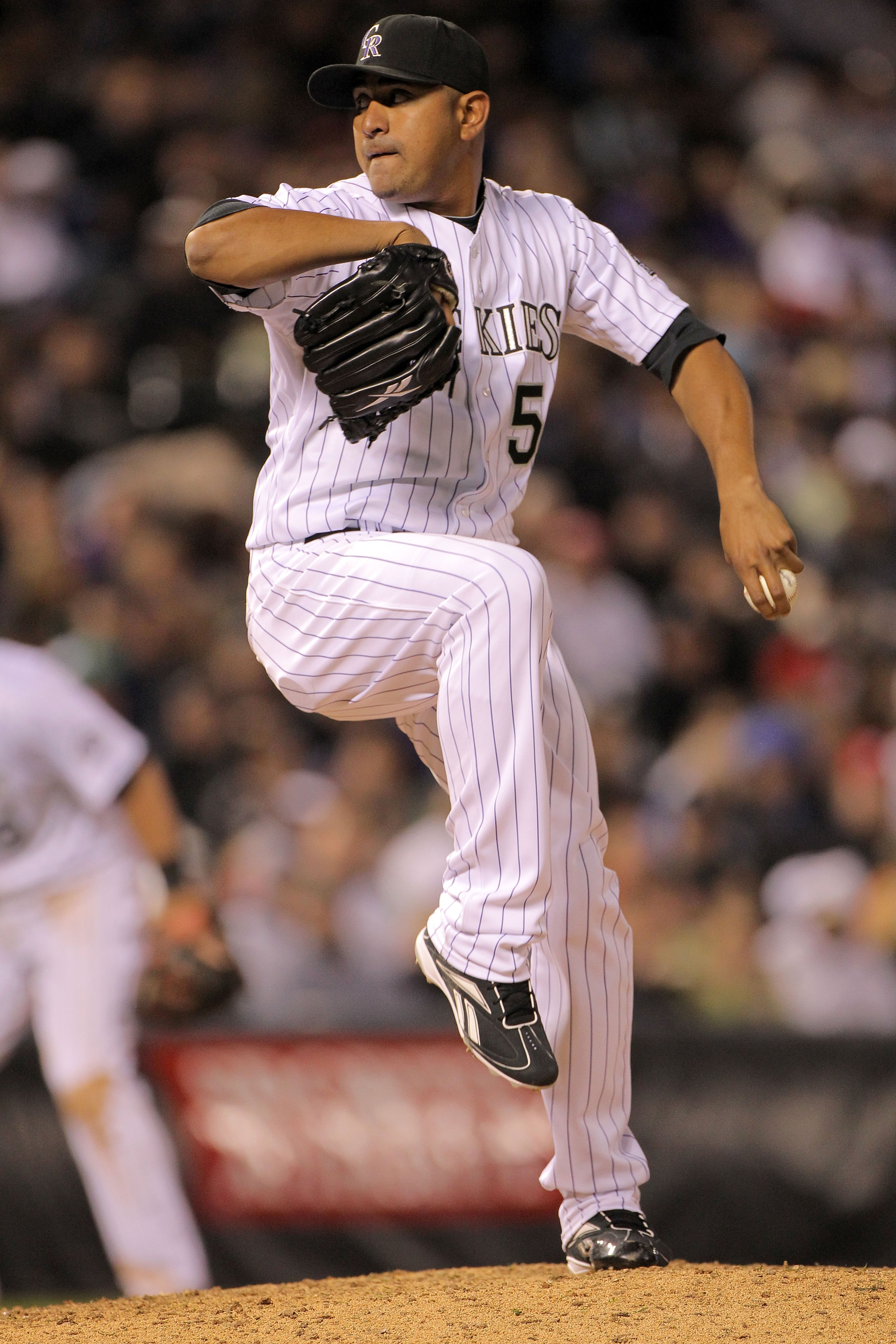 DENVER - APRIL 10:  Relief pitcher Franklin Morales #56 of the Colorado Rockies delivers against the San Diego Padres during MLB action at Coors Field on April 10, 2010 in Denver, Colorado. The Padres defeated the Rockies 5-4 in 14 innings.  (Photo by Dou