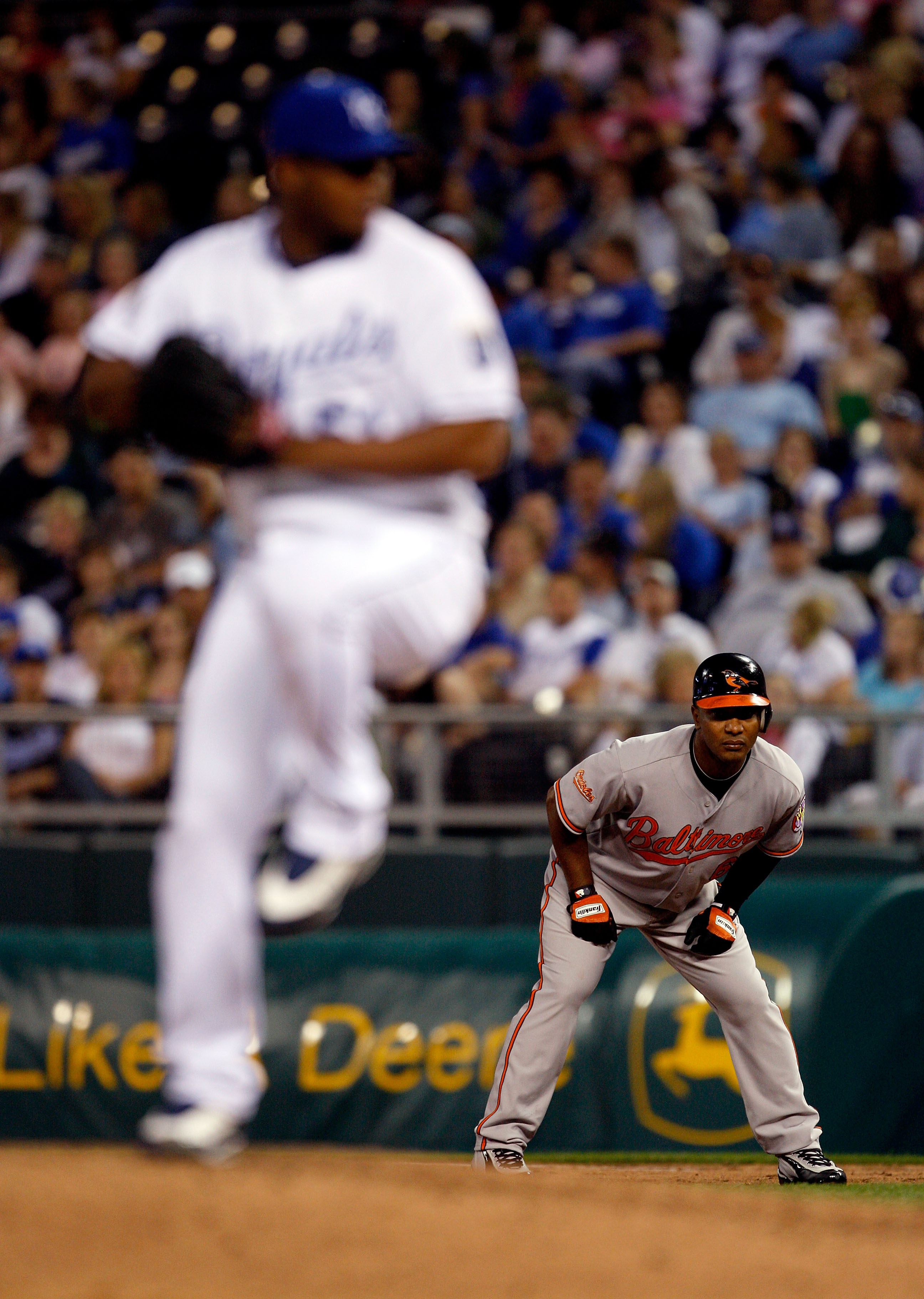 KANSAS CITY, MO - MAY 14:  Melvin Mora #6 of the Baltimore Orioles takes a lead as Robinson Tejada #51 of the Kansas City Royals during the game on May 14, 2009 at Kauffman Stadium in Kansas City, Missouri.  (Photo by Jamie Squire/Getty Images)