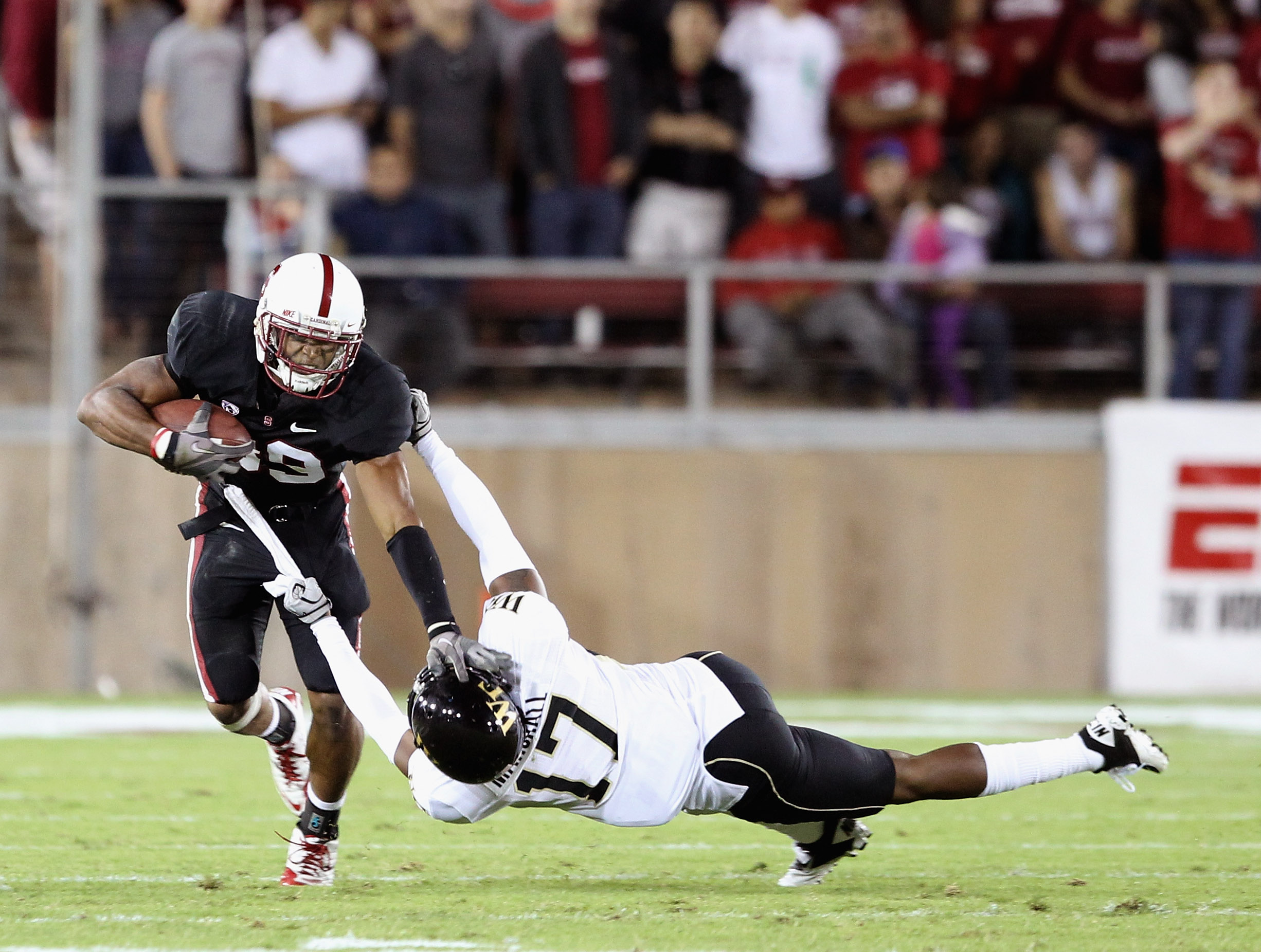 PALO ALTO, CA - SEPTEMBER 18:  Doug Baldwin #89of the Stanford Cardinal tries to fend off A.J. Marshall #17 of the Wake Forest Demon Deacons at Stanford Stadium on September 18, 2010 in Palo Alto, California.  (Photo by Ezra Shaw/Getty Images)