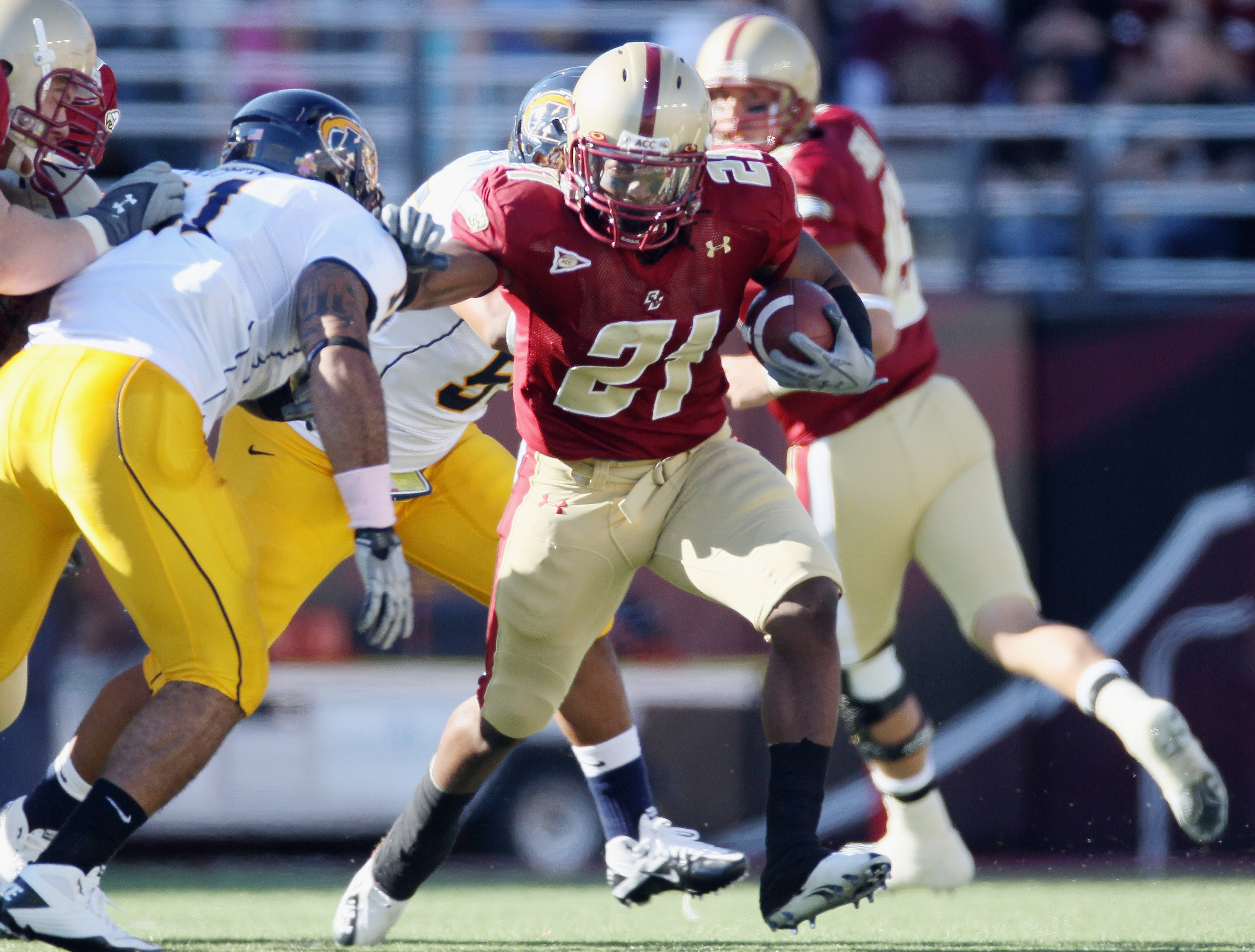 CHESTNUT HILL, MA - SEPTEMBER 11:   Sterlin Phifer #21 of the Boston College Eagles carries the ball as  Cobrani Mixon #11 of the Kent State Golden Flashes defends on September 11, 2010 at Alumni Stadium in Chestnut Hill, Massachusetts. Boston College def