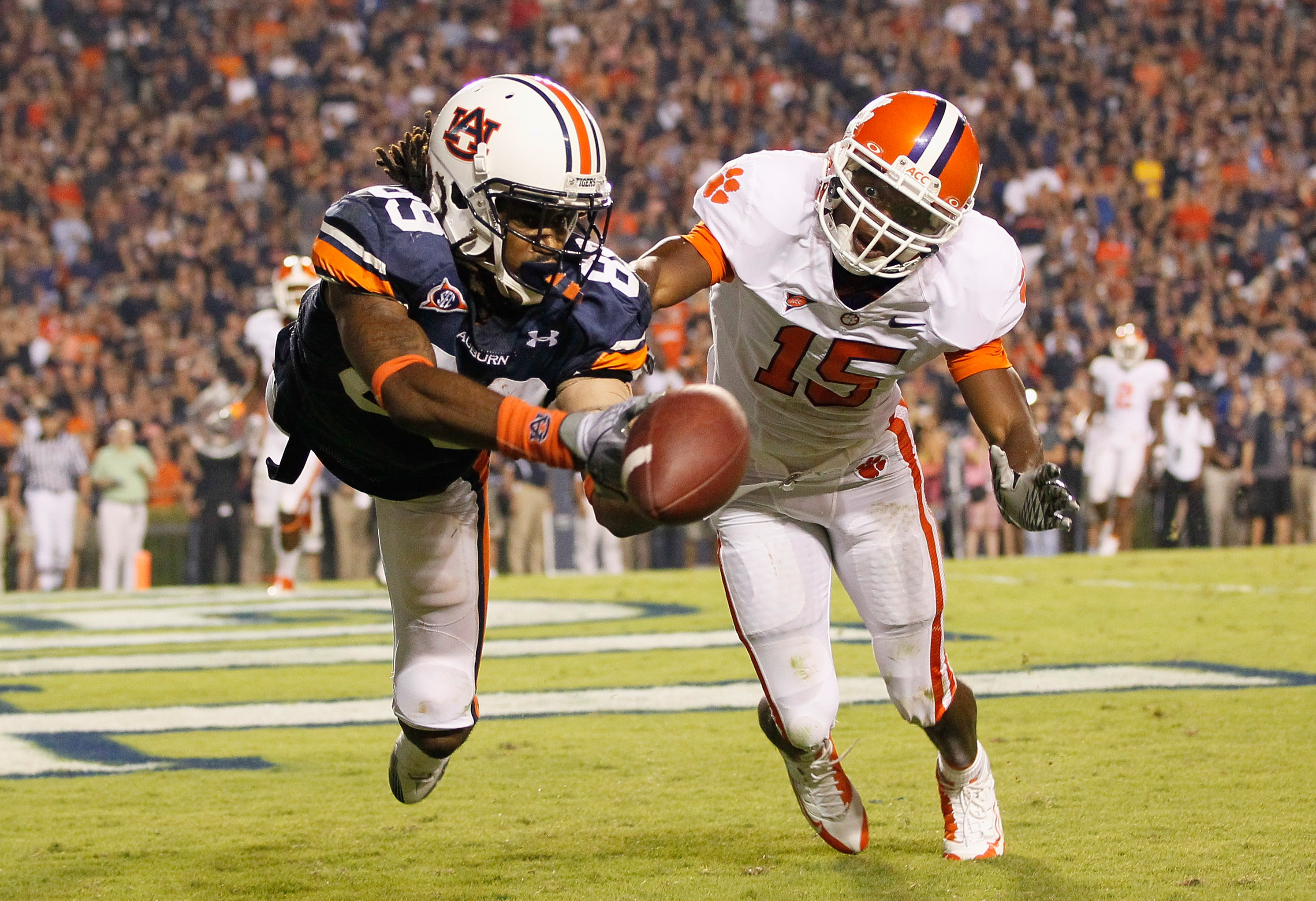 AUBURN, AL - SEPTEMBER 18:  Darvin Adams #89 of the Auburn Tigers fails to pull in this touchdown reception in overtime against Coty Sensabaugh #15 of the Clemson Tigers at Jordan-Hare Stadium on September 18, 2010 in Auburn, Alabama.  (Photo by Kevin C.