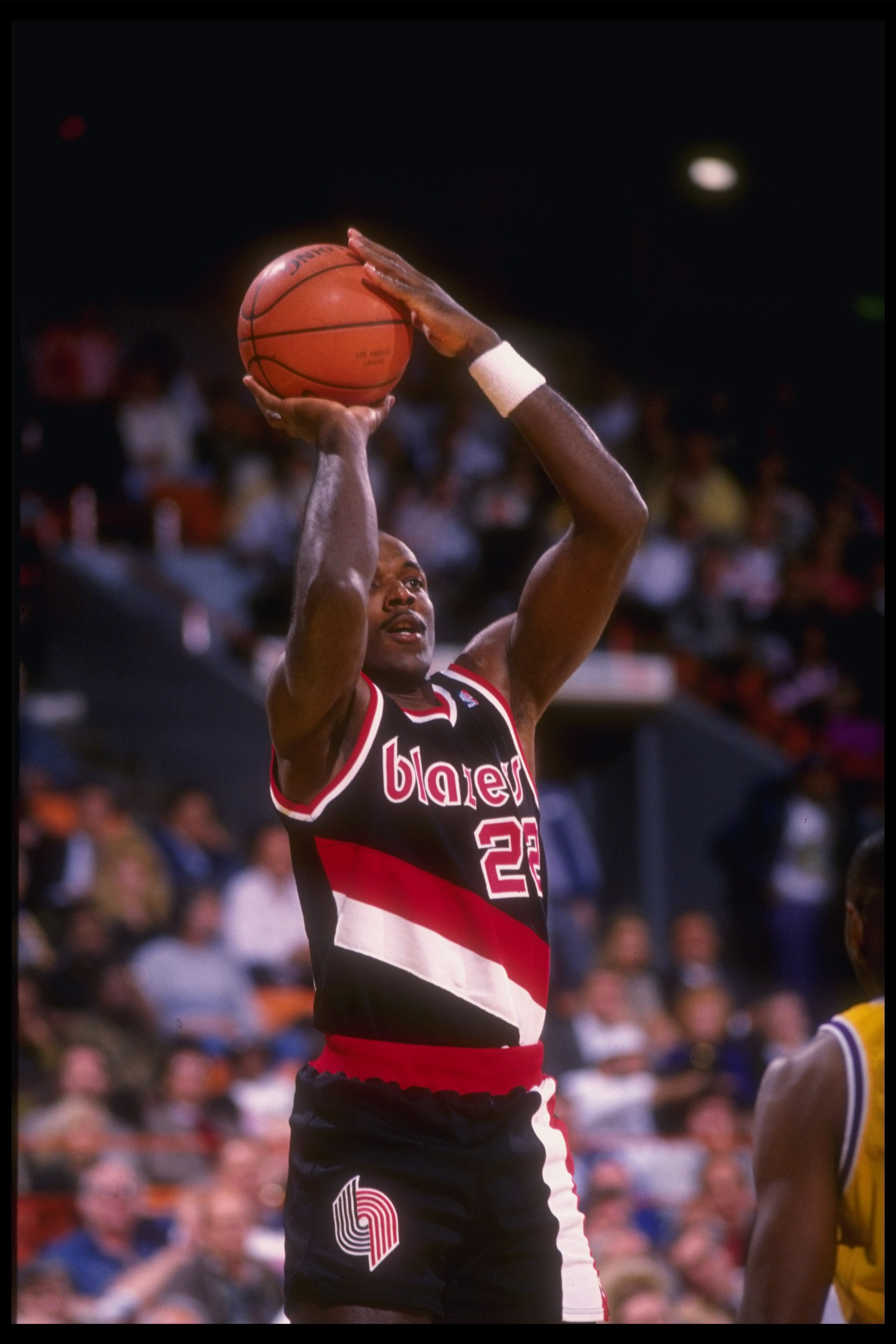 Guard Clyde Drexler of the Portland Trail Blazers shoots the ball during a game against the Los Angeles Lakers at the Rose Garden in Portland, Oregon.