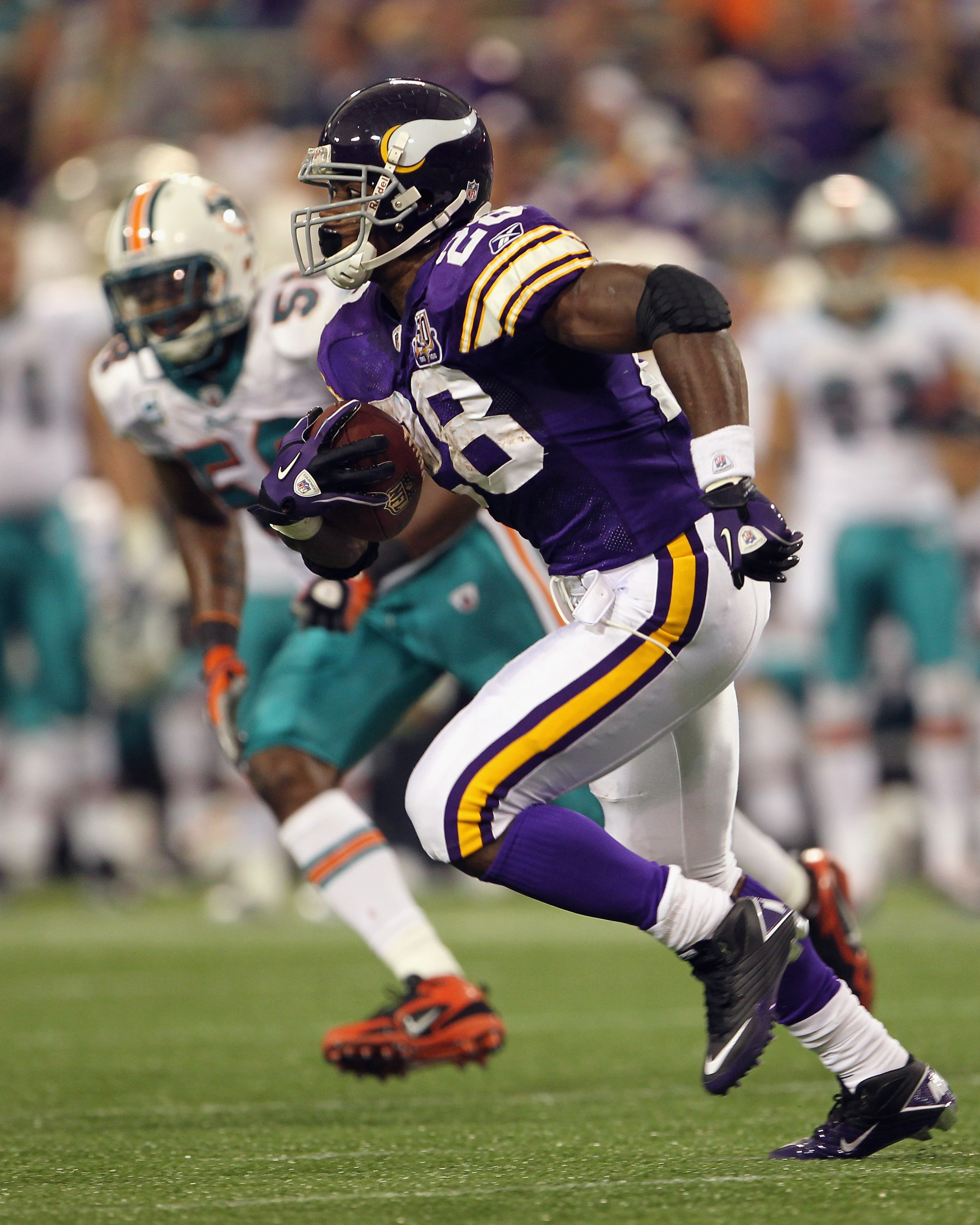 MINNEAPOLIS - SEPTEMBER 19:  Adrian Peterson #28 of the Minnesota Vikings carries the ball during the game against the Miami Dolphins on September 19, 2010 at Hubert H. Humphrey Metrodome in Minneapolis, Minnesota.  (Photo by Jamie Squire/Getty Images)