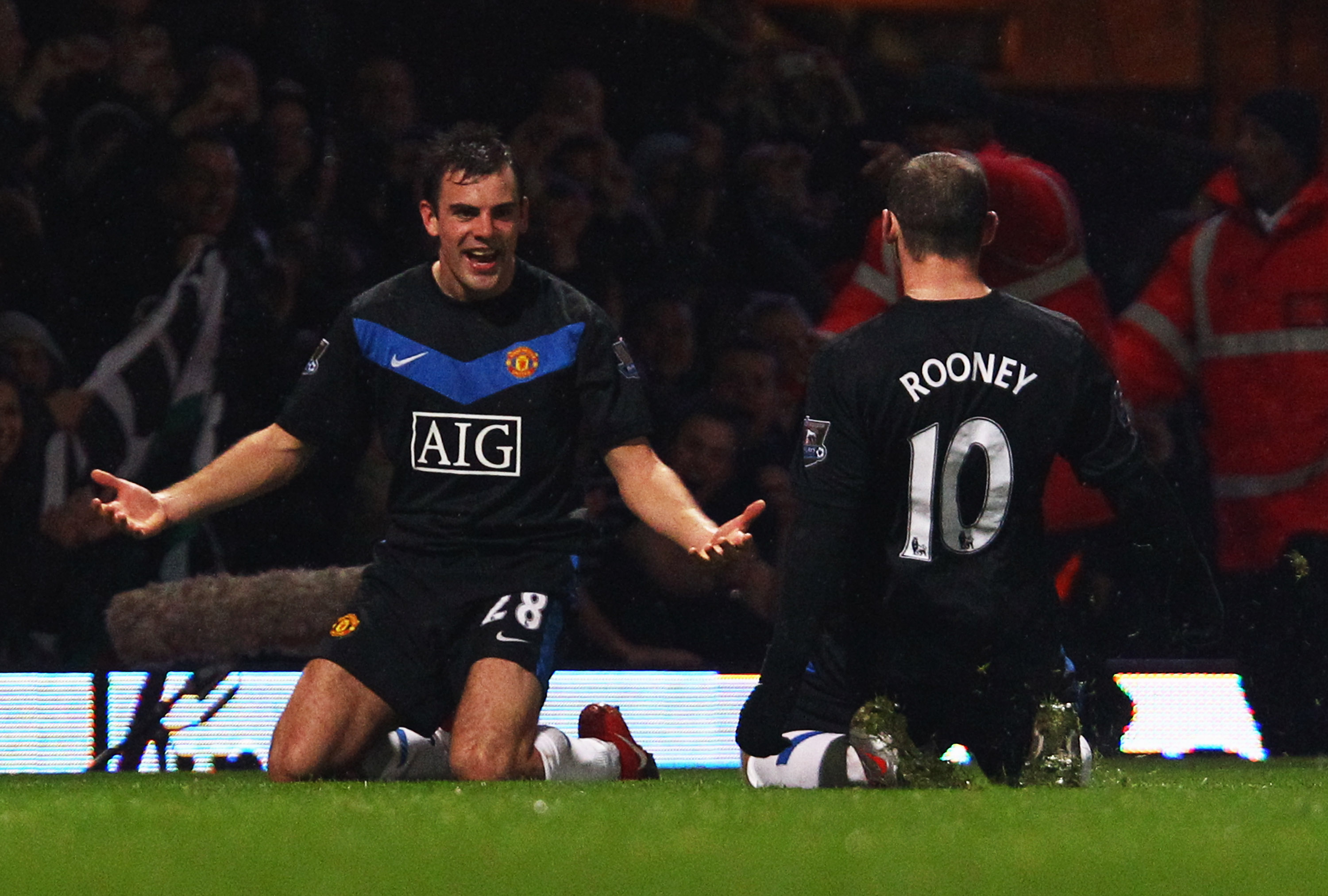 LONDON, ENGLAND - DECEMBER 05:  Darron Gibson of Manchester United celebrates with team mate Wayne Rooney (10) as he scores their second goal during the Barclays Premier League match between West Ham United and Manchester United at Upton Park on December