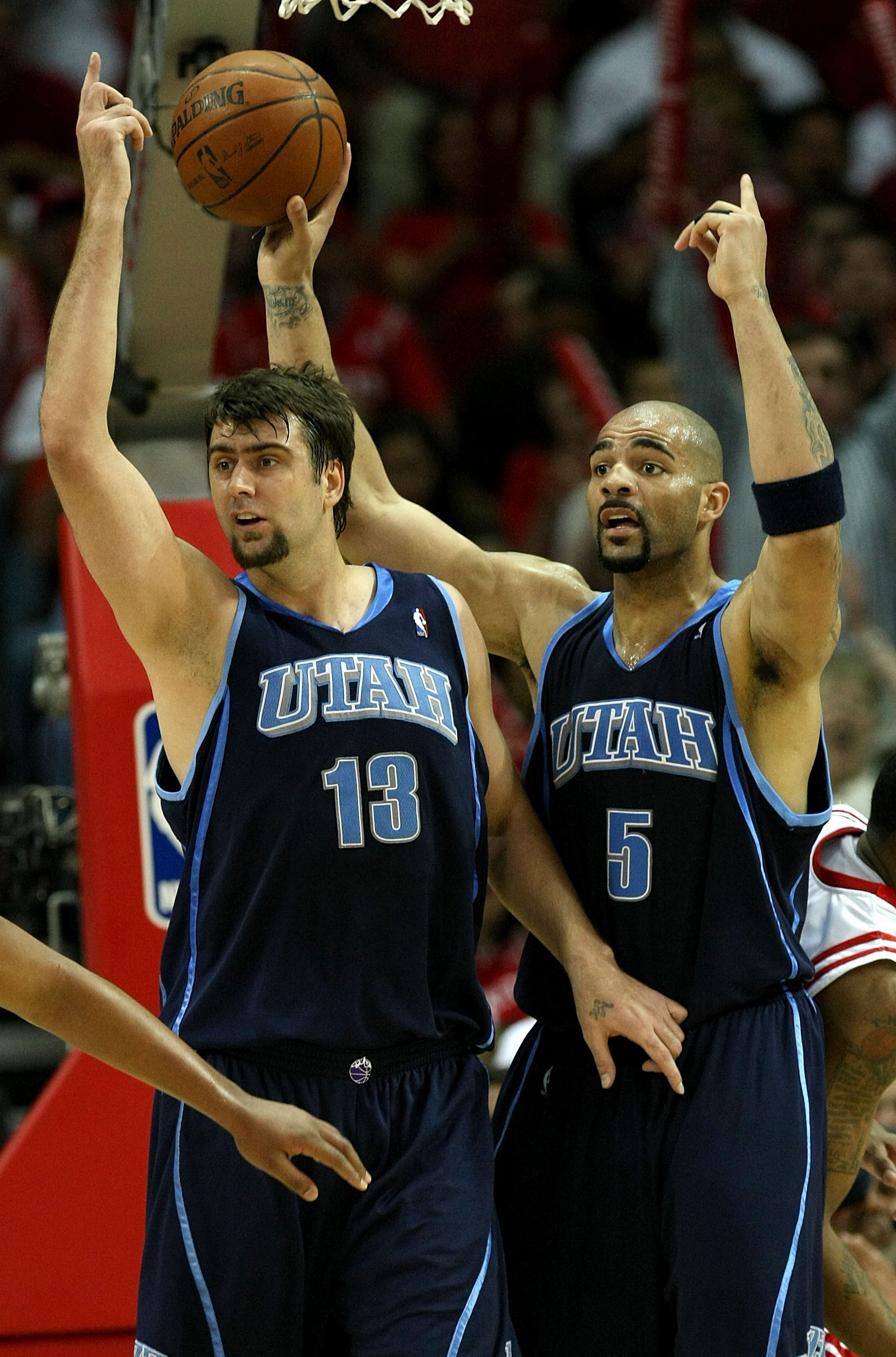 HOUSTON - APRIL 29:  Mehmet Okur #13 and Carlos Boozer #5 of the Utah Jazz lobby unsuccessfully for an offensive goaltending call against the Houston Rockets in Game Five of the Western Conference Quarterfinals during the 2008 NBA Playoffs at the Toyota C