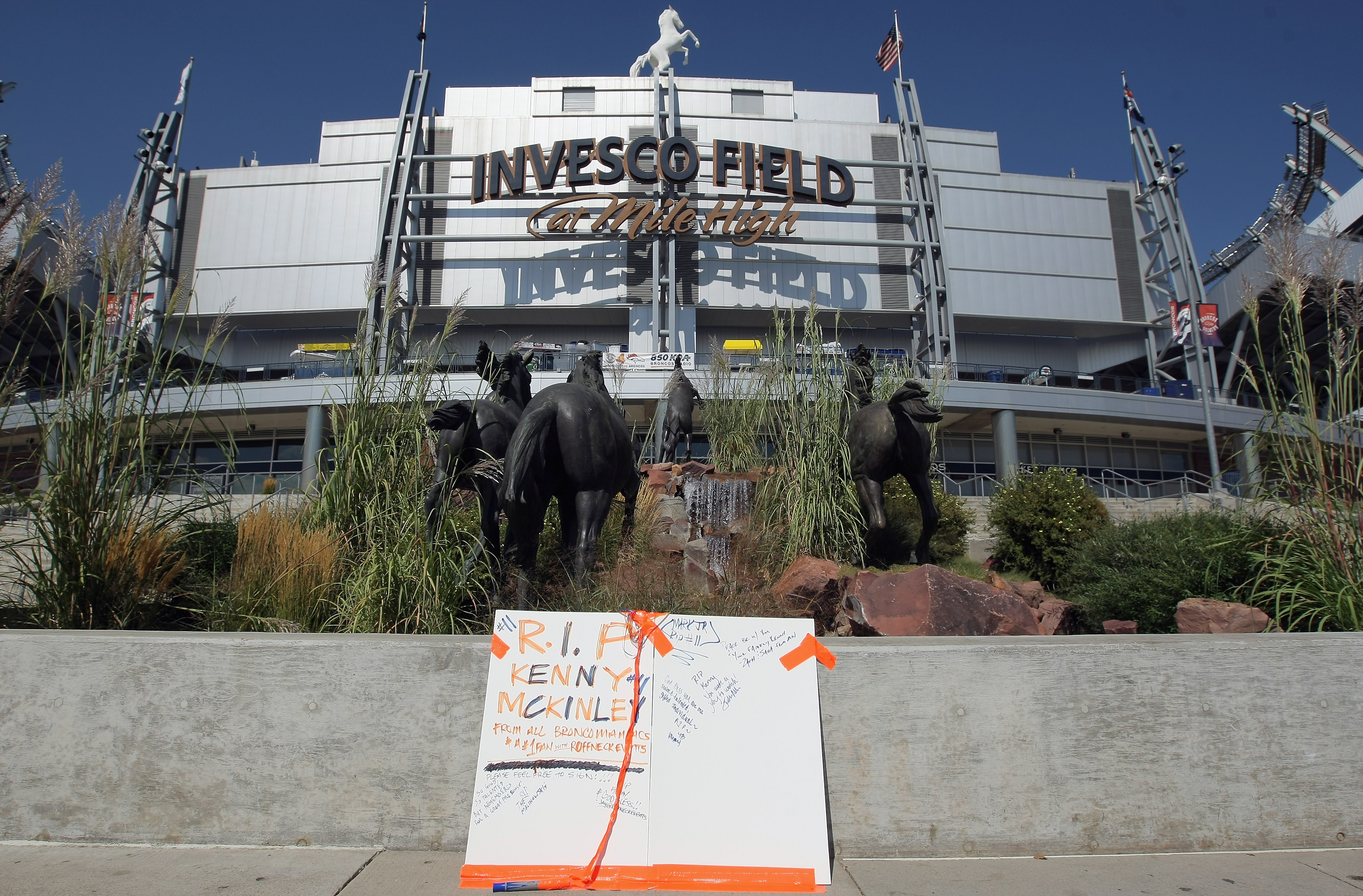 ENGLEWOOD, CO - SEPTEMBER 21:  A poster is placed on the plaza outside stadium for fans to sign in memory of Denver Bronco wide receiver Kenny McKinley at Invesco Field at Mile High on September 21, 2010 in Denver, Colorado. McKinley, 23, was found dead i
