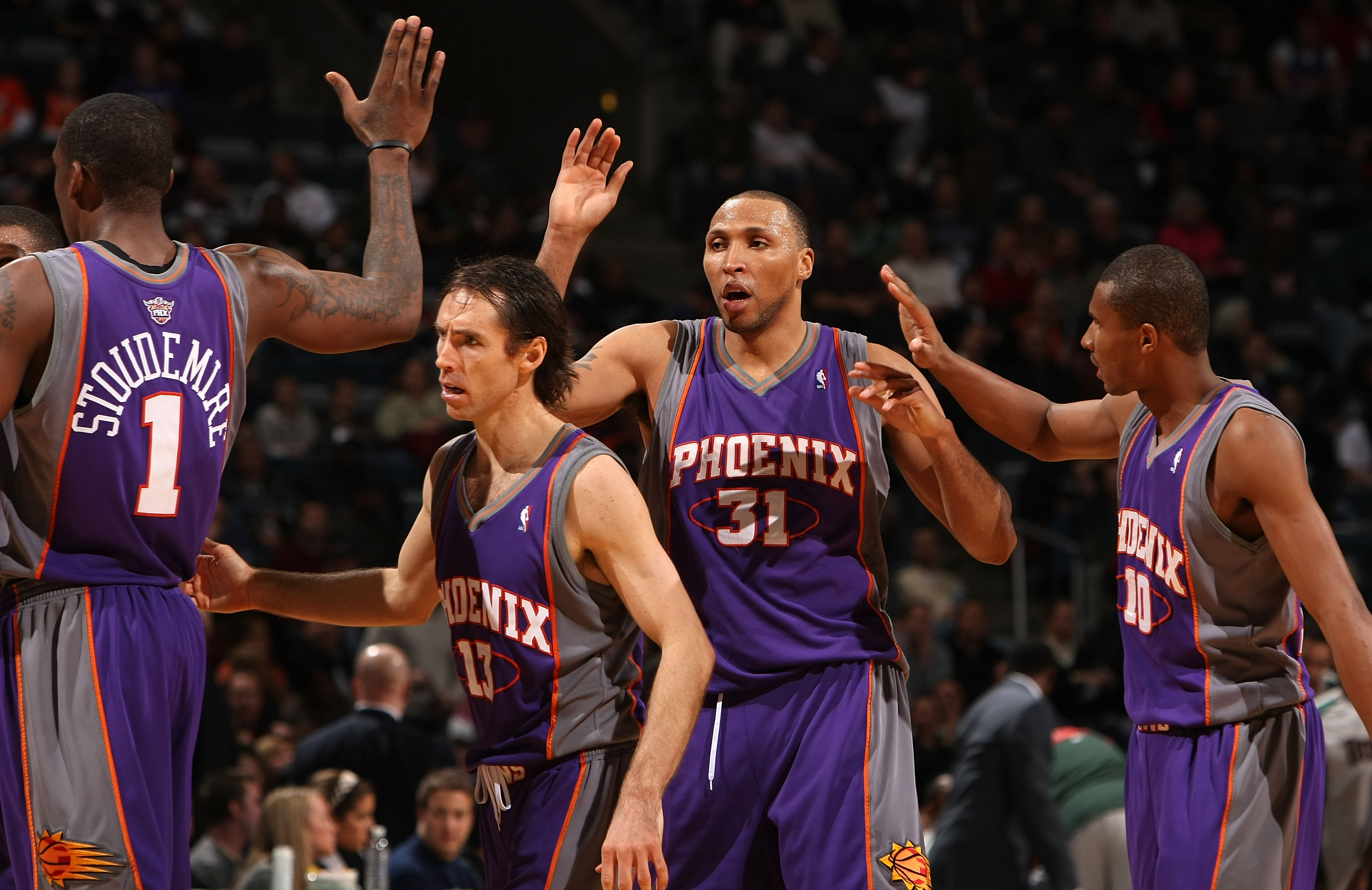 MILWAUKEE - JANUARY 22:  (L-R) Amare Stoudemire #1, Steve Nash #13, Shawn Marion #31 and Leandro Barbosa #10 of the Phoenix Suns celebrate late in the game against the Milwaukee Bucks at the Bradley Center on January 22, 2008 in Milwaukee, Wisconsin. The
