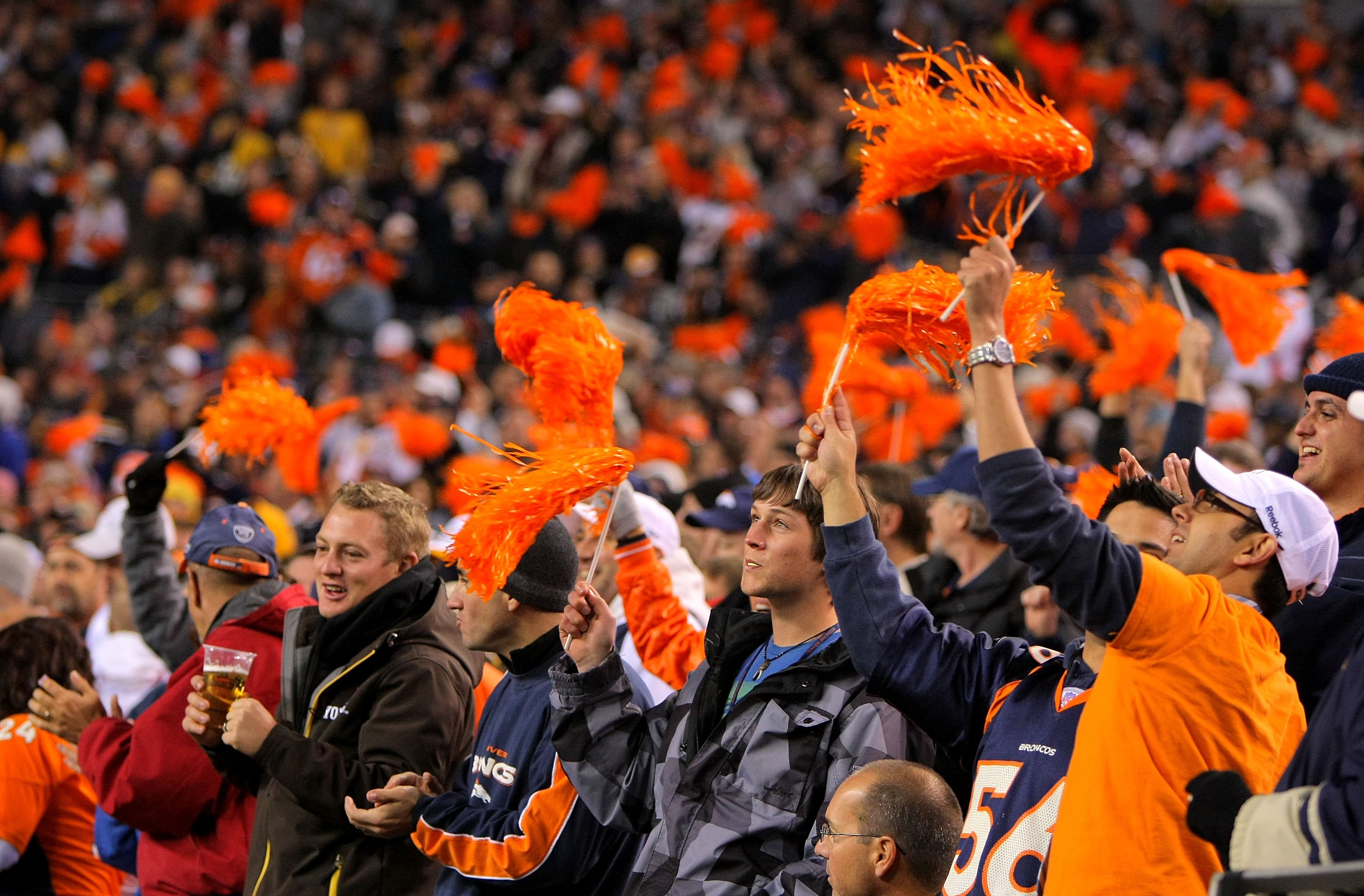 DENVER - NOVEMBER 09:  Fans support the Denver Broncos against the Pittsburgh Steelers defense on during NFL action at Invesco Field at Mile High on November 9, 2009 in Denver, Colorado. The Steelers defeated the Broncos 28-10.  (Photo by Doug Pensinger/G