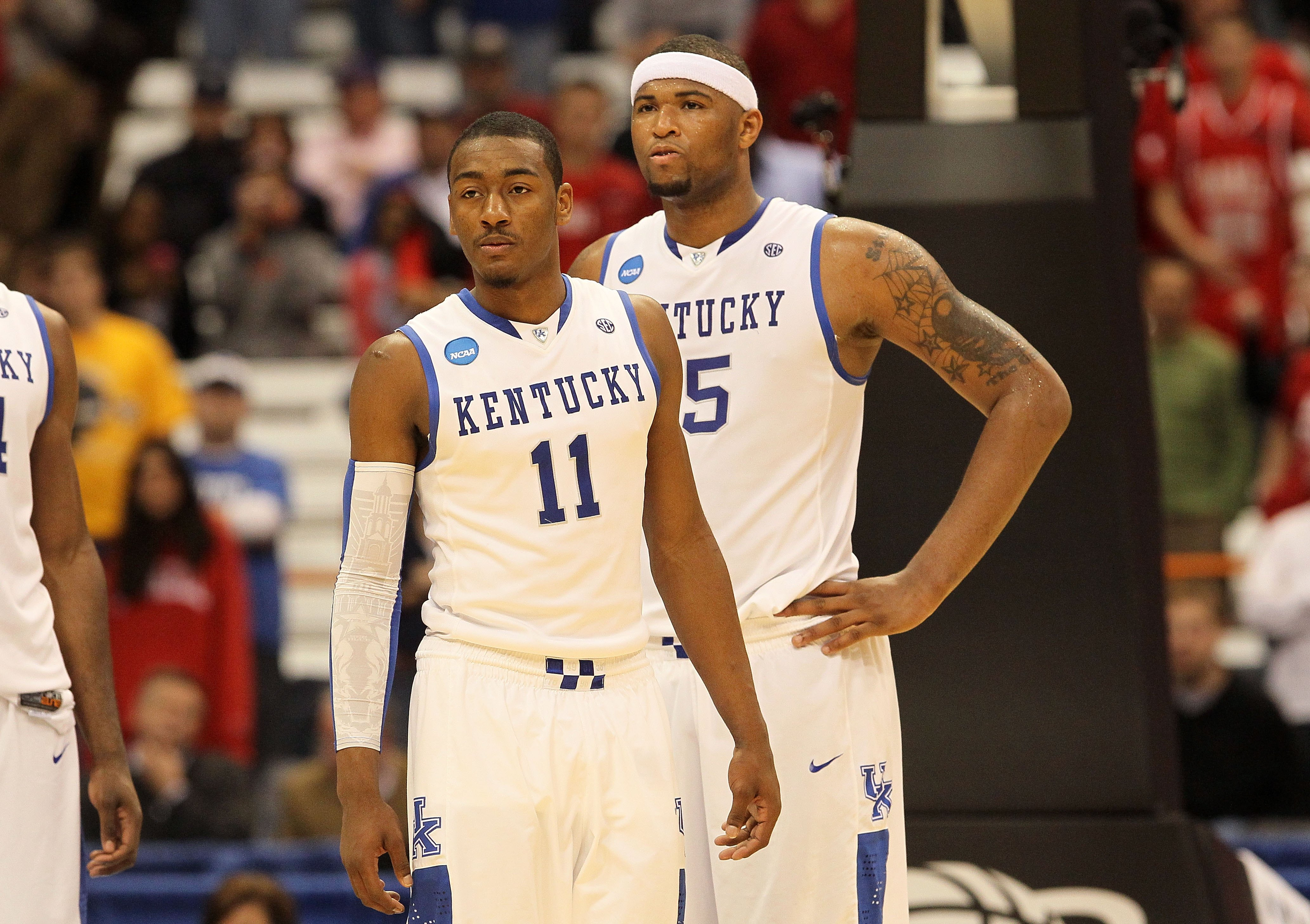 SYRACUSE, NY - MARCH 25:  (L-R) John Wall #11 and DeMarcus Cousins #15 of the Kentucky Wildcats look on against the Cornell Big Red during the east regional semifinal of the 2010 NCAA men's basketball tournament at the Carrier Dome on March 25, 2010 in Sy