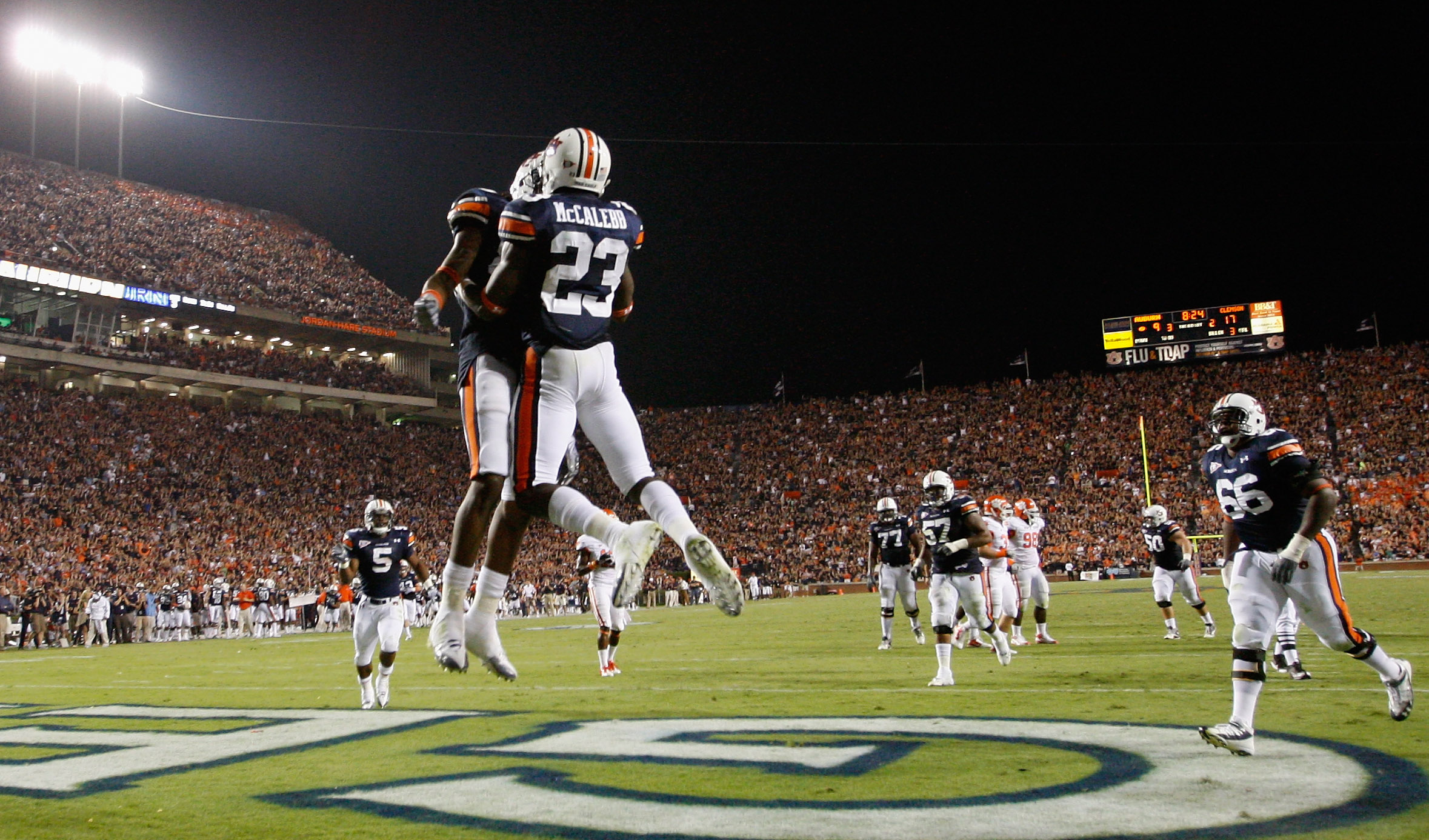 AUBURN, AL - SEPTEMBER 18:  Onterio McCalebb #23 of the Auburn Tigers celebrates his touchdown against the Clemson Tigers with Darvin Adams #89 at Jordan-Hare Stadium on September 18, 2010 in Auburn, Alabama.  (Photo by Kevin C. Cox/Getty Images)