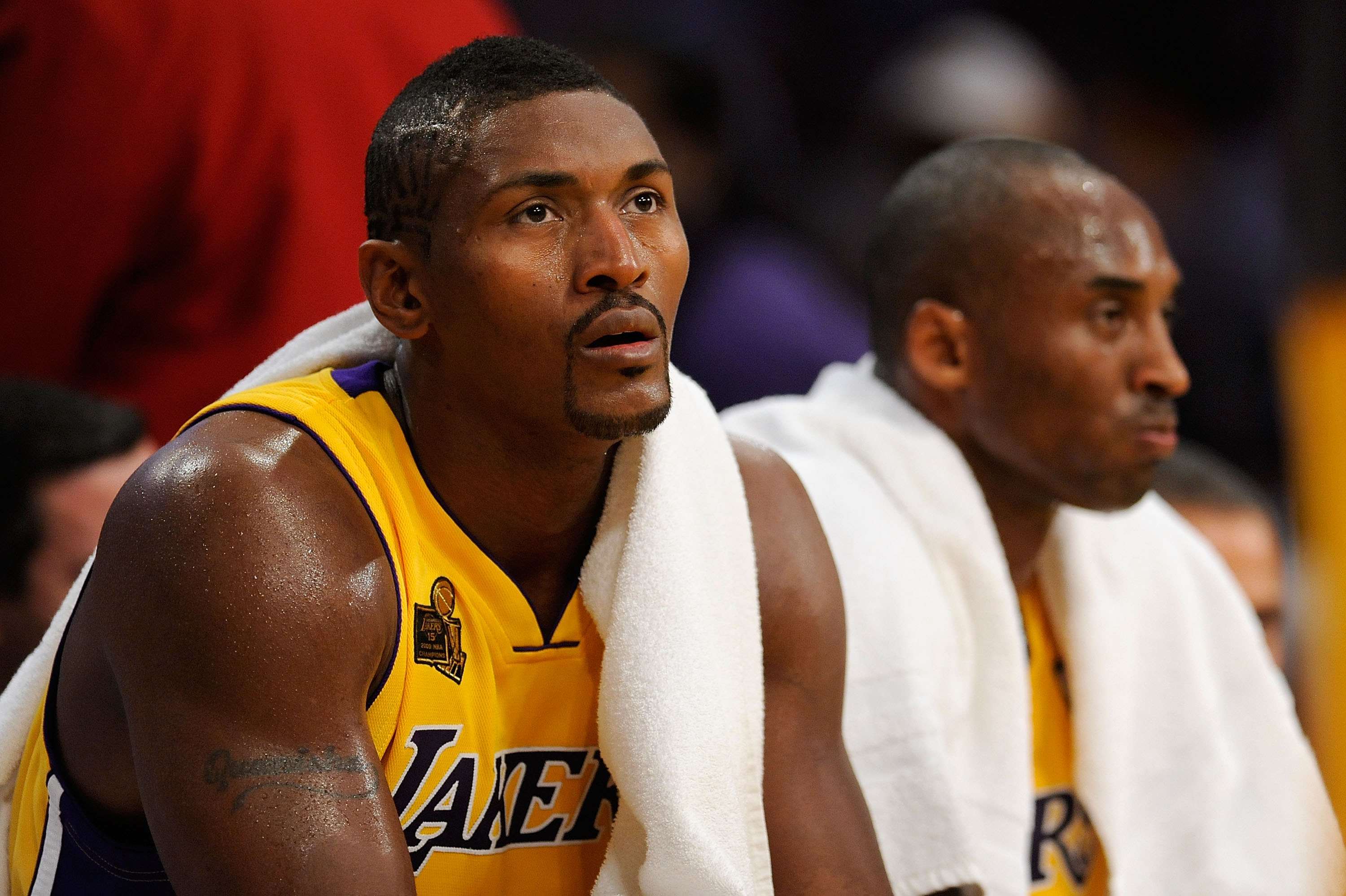 LOS ANGELES, CA - OCTOBER 27:  (L-R) Ron Artest #37 and Kobe Bryant #24 of the Los Angeles Lakers sit on the bench during the season opening game against the Los Angeles Clippers at Staples Center on October 27, 2009 in Los Angeles, California.  The Laker