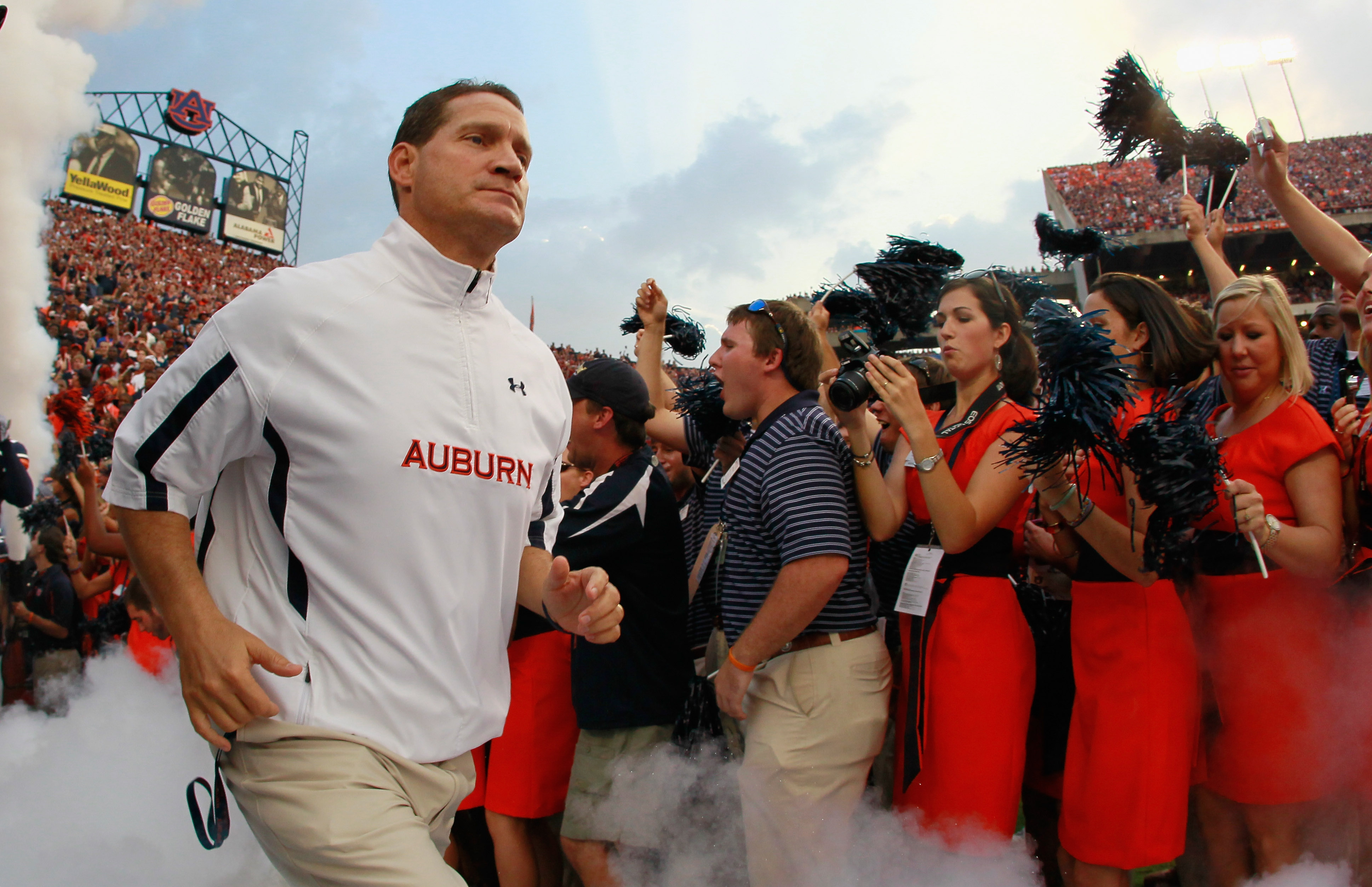 AUBURN, AL - SEPTEMBER 18:  Head coach Gene Chizik of the Auburn Tigers leads his team onto the field to face the Clemson Tigers at Jordan-Hare Stadium on September 18, 2010 in Auburn, Alabama.  (Photo by Kevin C. Cox/Getty Images)