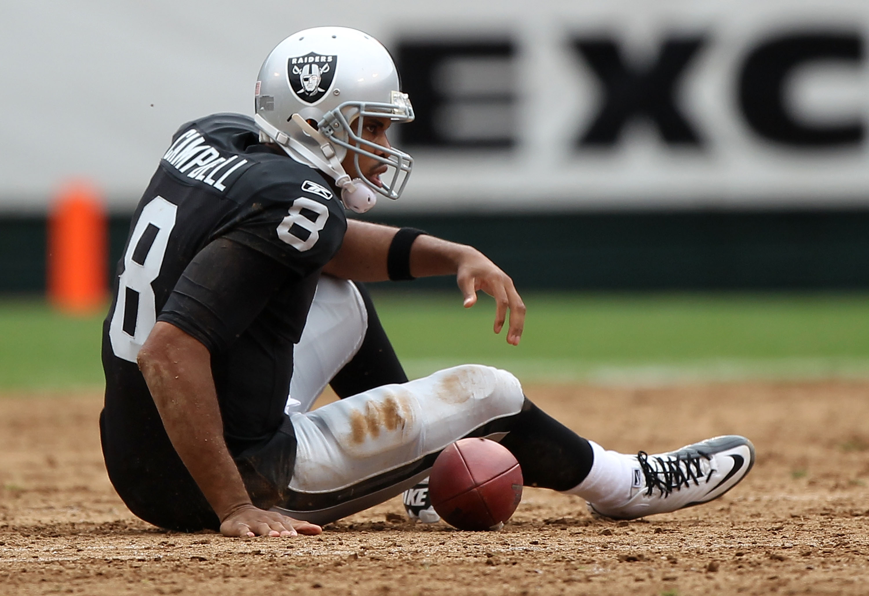 OAKLAND, CA - SEPTEMBER 19:  Jason Campbell #8 of the Oakland Raiders lies on the ground after being sacked against the St. Louis Rams during an NFL game at Oakland-Alameda County Coliseum on September 19, 2010 in Oakland, California.  (Photo by Jed Jacob