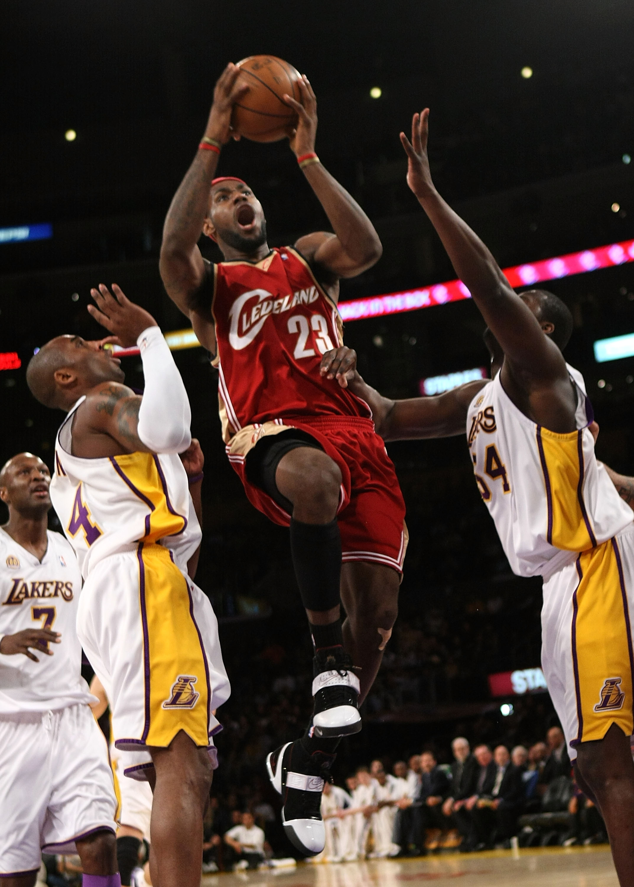 LOS ANGELES - JANUARY 27:  LeBron James #23 of the Cleveland Cavaliers goes up for a shot between Kobe Bryant #24 and Kwame Brown #54 of the Los Angeles Lakers at Staples Center January 27, 2008 in Los Angeles, California.   NOTE TO USER: User expressly a