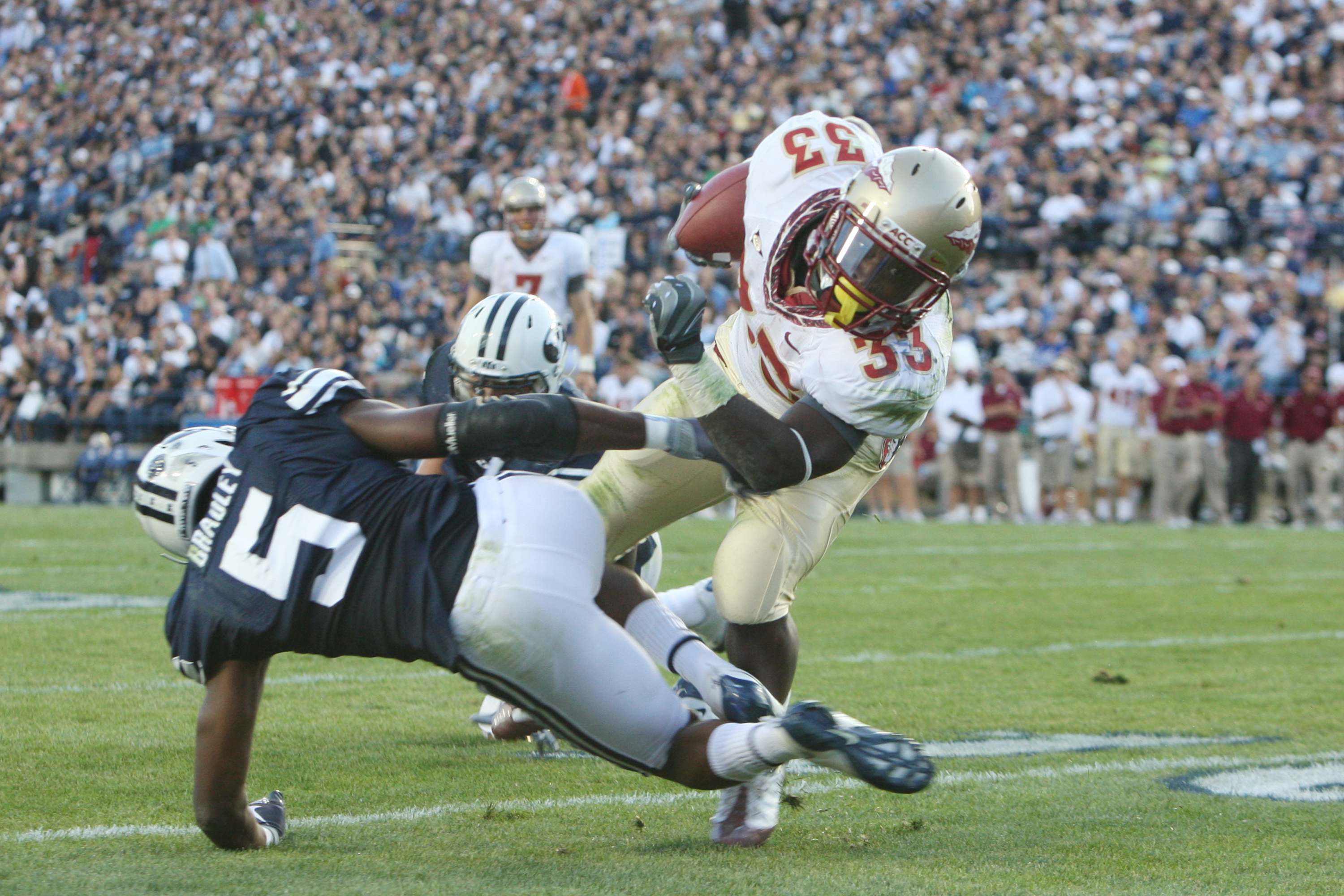 PROVO - SEPTEMBER 19:  Ty Jones #33 of Florida State gets tackled by Brandon Bradley #5 of Brigham Young University at La Vell Edwards Stadium on September 19, 2009 in Provo, Utah.  (Photo by Melissa Majchrzak/Getty Images)