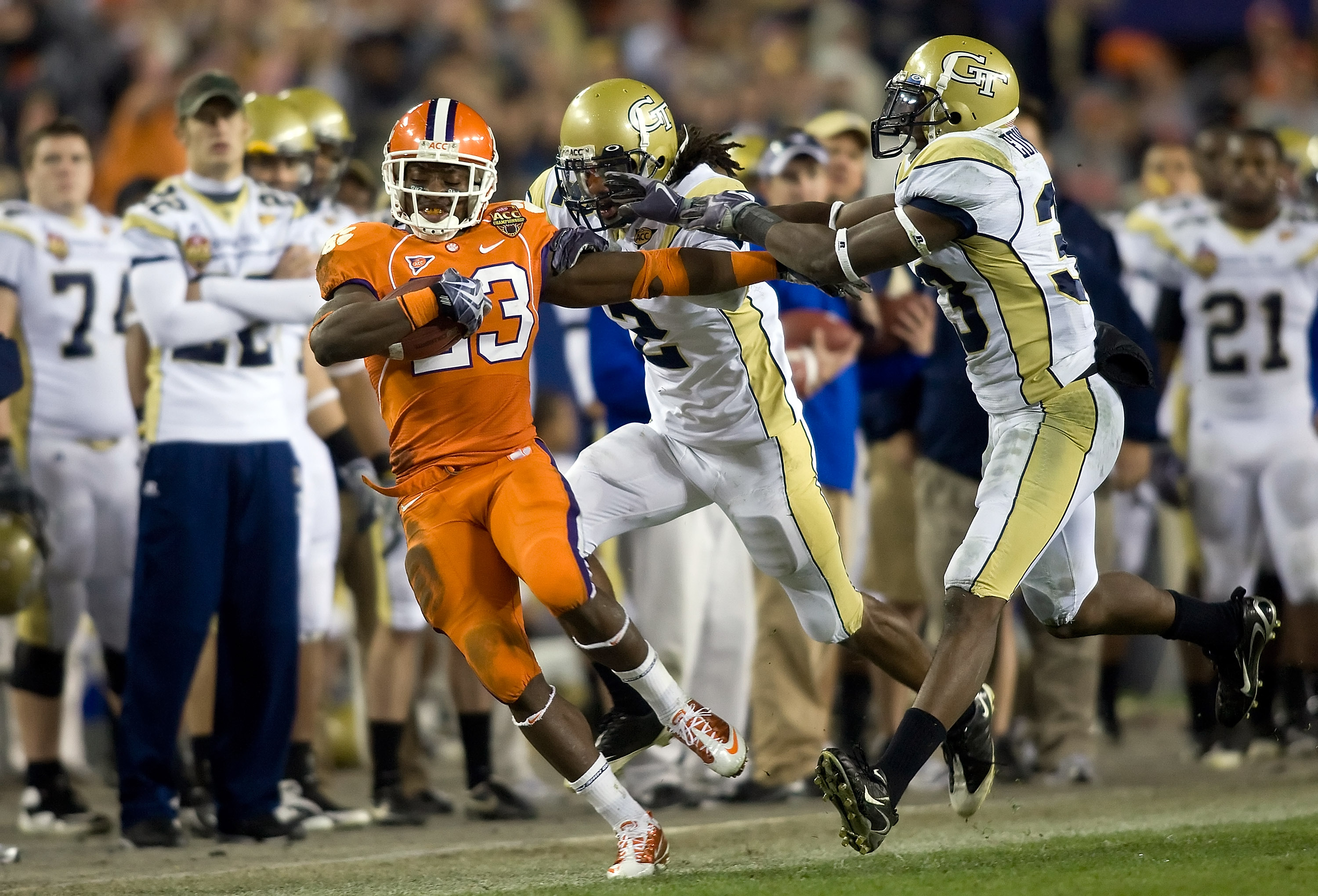 TAMPA, FL - DECEMBER 05:  Running back Andre Ellington #23 of the Clemson Tigers is knocked out of bounds by defenders Mario Butler #2 and Mario Edwards #33 of the Georgia Tech Yellow Jackets in the 2009 ACC Football Championship game at Raymond James Sta