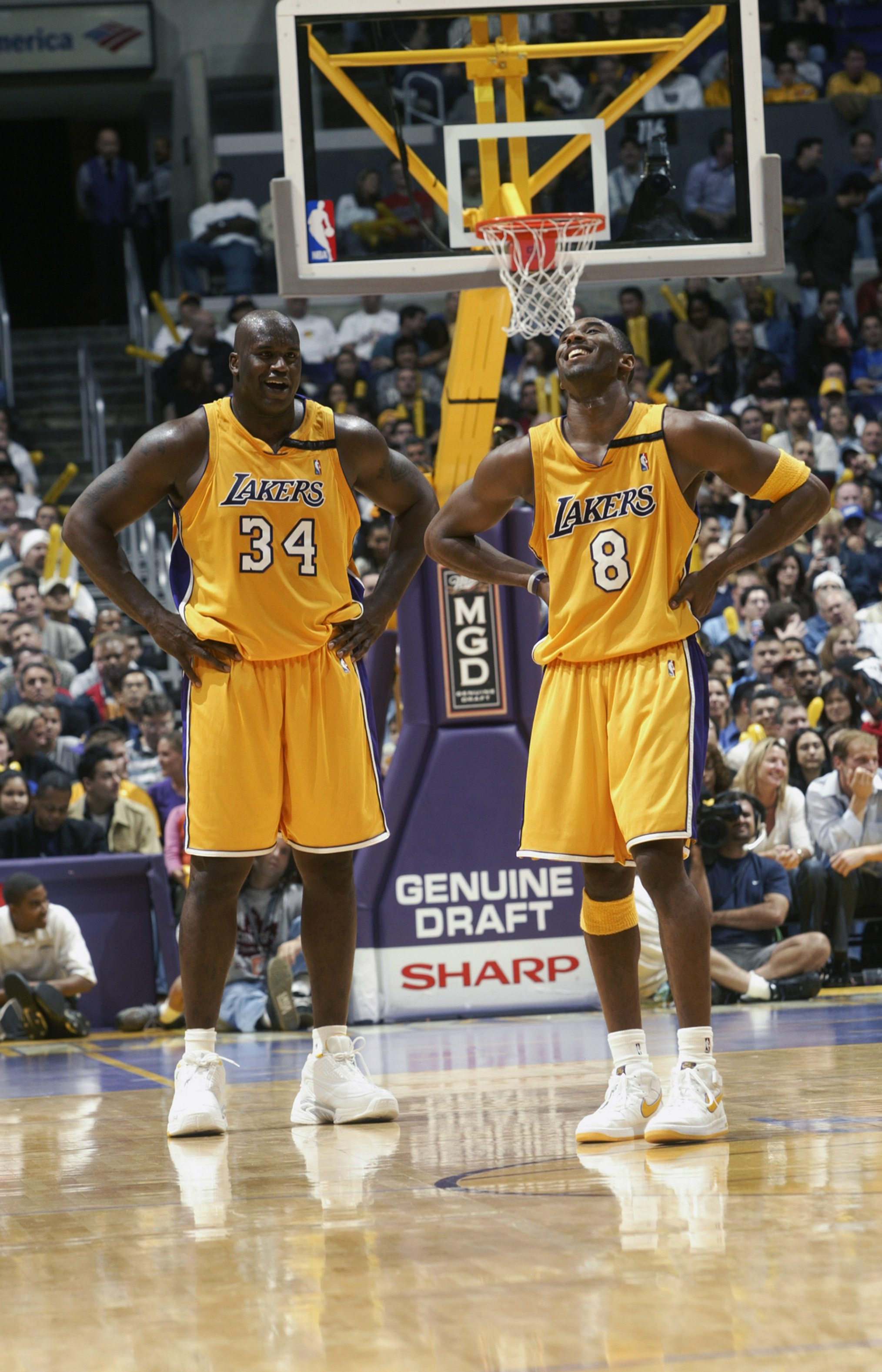 LOS ANGELES - NOVEMBER 22:  Shaquille O'Neal #34 and Kobe Bryant #8 of the Los Angeles Lakers laugh during the NBA game against the Chicago Bulls at Staples Center on November 22, 2002 in Los Angeles, California.  The Lakers won 86-73.  NOTE TO USER: User