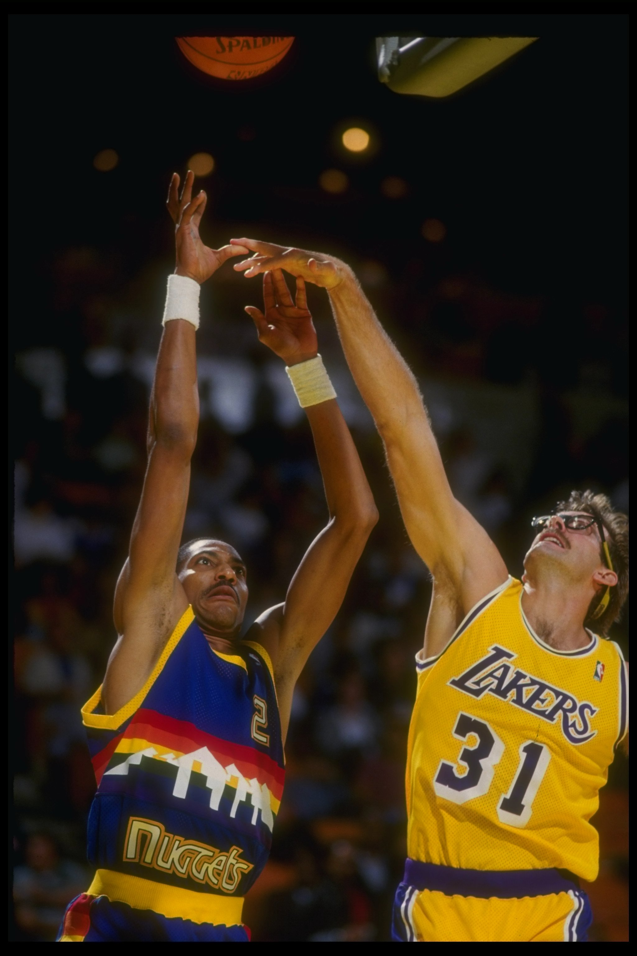 1980''s:  Guard Alex English of the Denver Nuggets shoots the ball during a game versus the Los Angeles Lakers at the Forum in Inglewood, California. Mandatory Credit: Stephen Dunn  /Allsport Mandatory Credit: Stephen Dunn  /Allsport