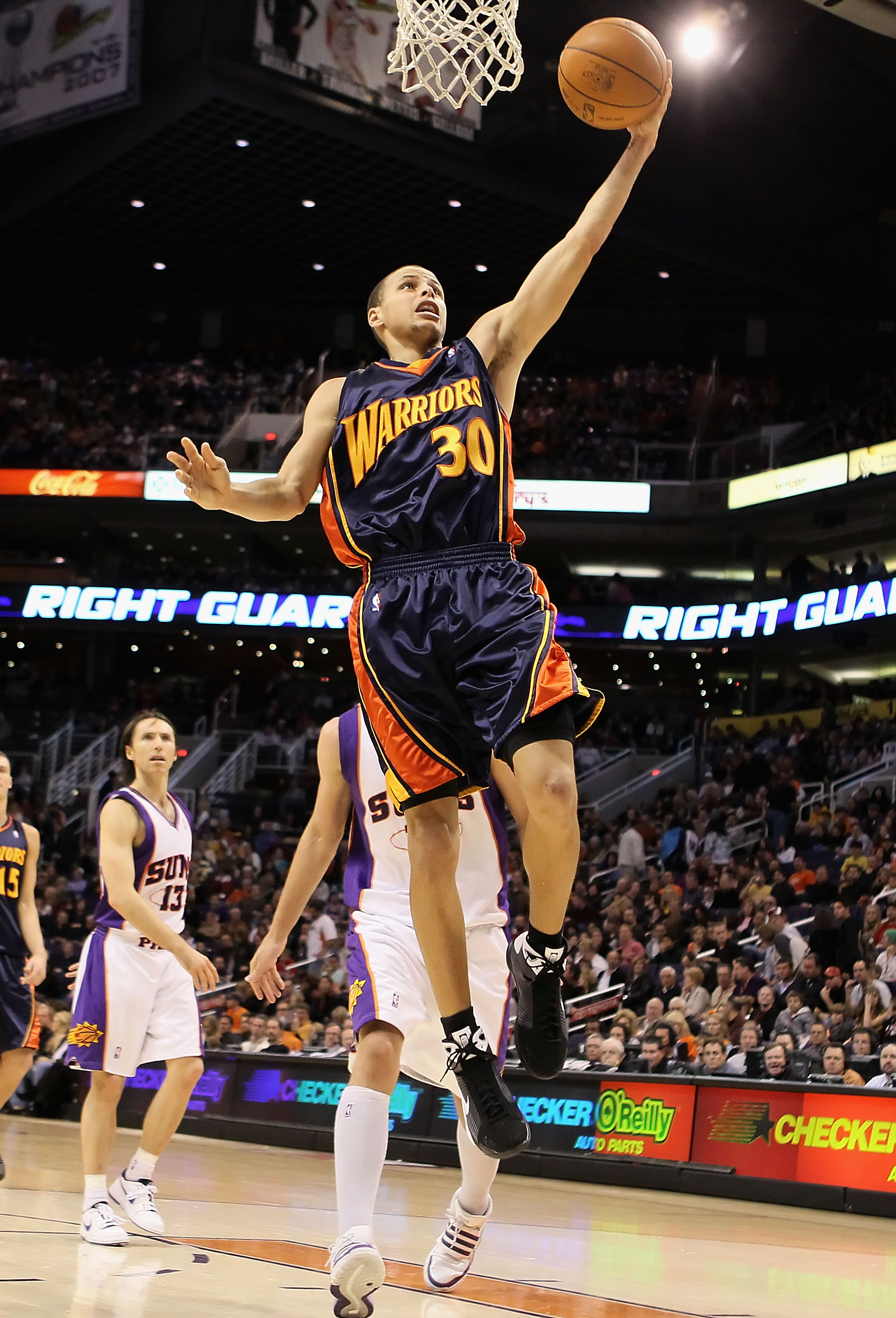PHOENIX - JANUARY 23:  Stephen Curry #30 of the Golden State Warriors lays up a shot against the Phoenix Suns during the NBA game at US Airways Center on January 23, 2010 in Phoenix, Arizona. NOTE TO USER: User expressly acknowledges and agrees that, by d