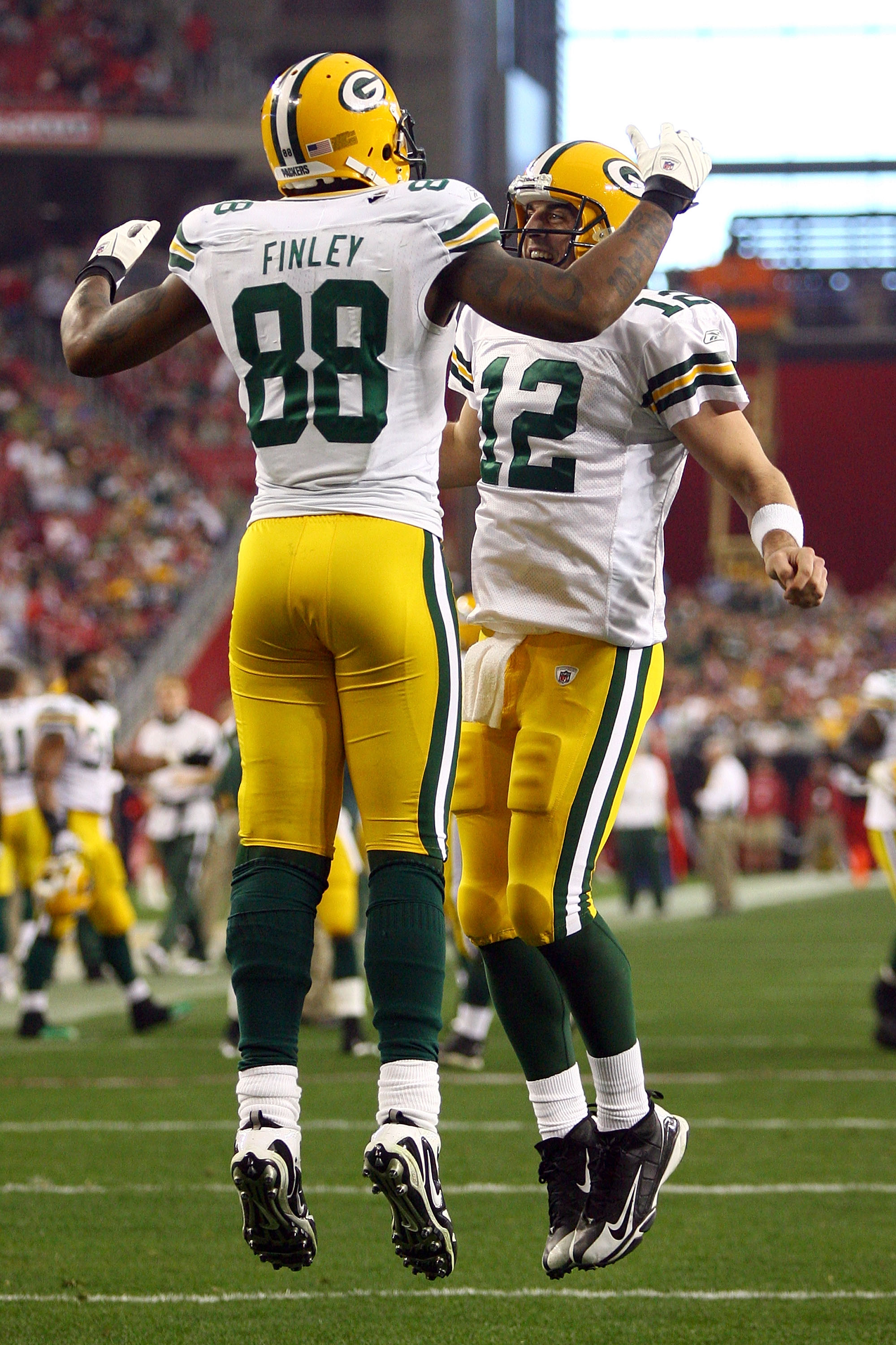 GLENDALE, AZ - JANUARY 03:  Jermichael Finley #88 of the Green Bay Packers and quarterback Aaron Rodgers #12 celebrate after Finley catches a five-yard touchdown against the Arizona Cardinals in the third quarter at University of Phoenix Stadium on Januar