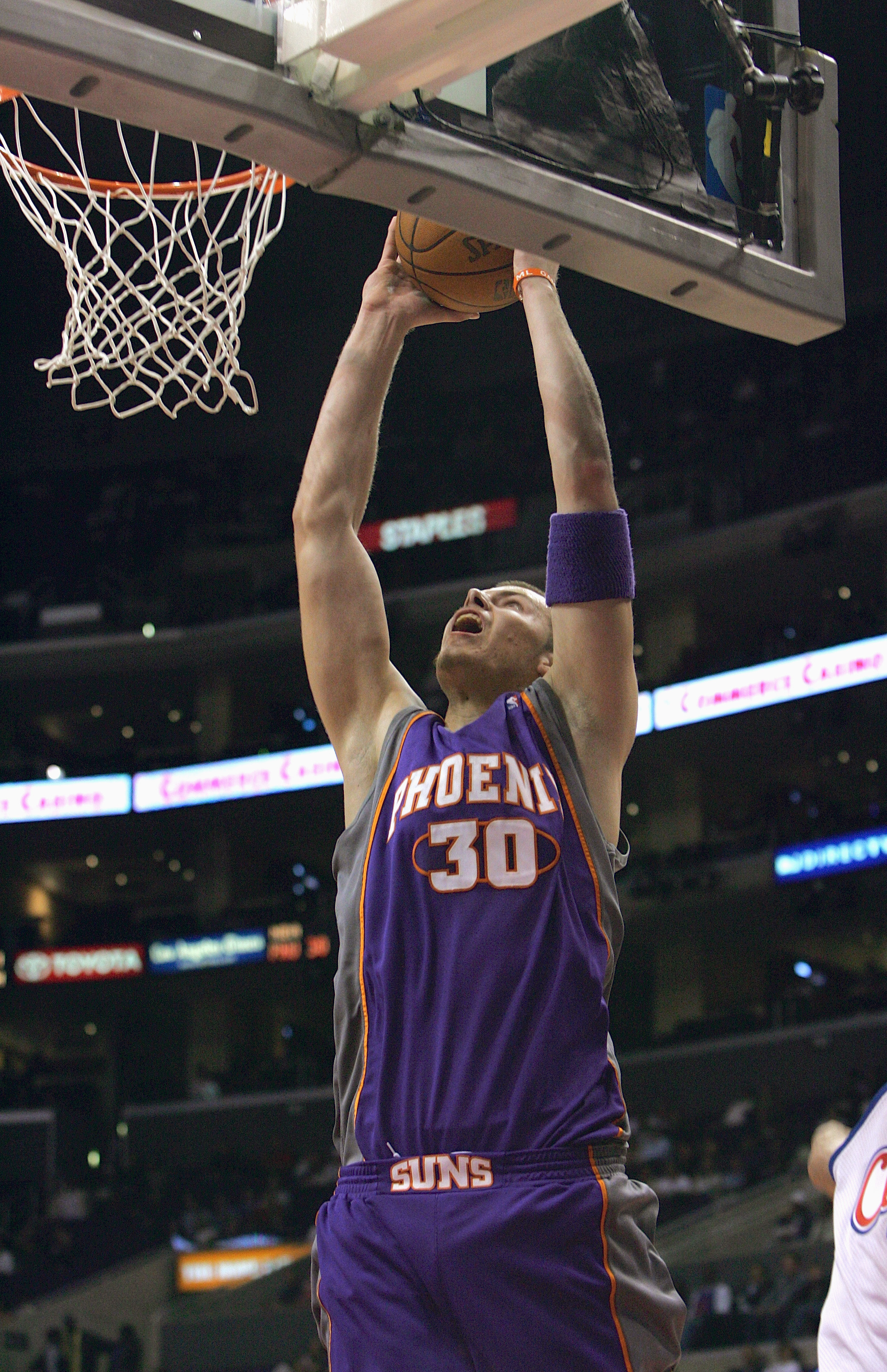 LOS ANGELES - OCTOBER 28:  Maciej Lampe #30 of the Phoenix Suns looks to passes shoots dribbles against of the Los Angeles Clippers during a preseason game on October 28, 2004 at Staples Center in Los Angeles, California. NOTE TO USER: User expressly ackn