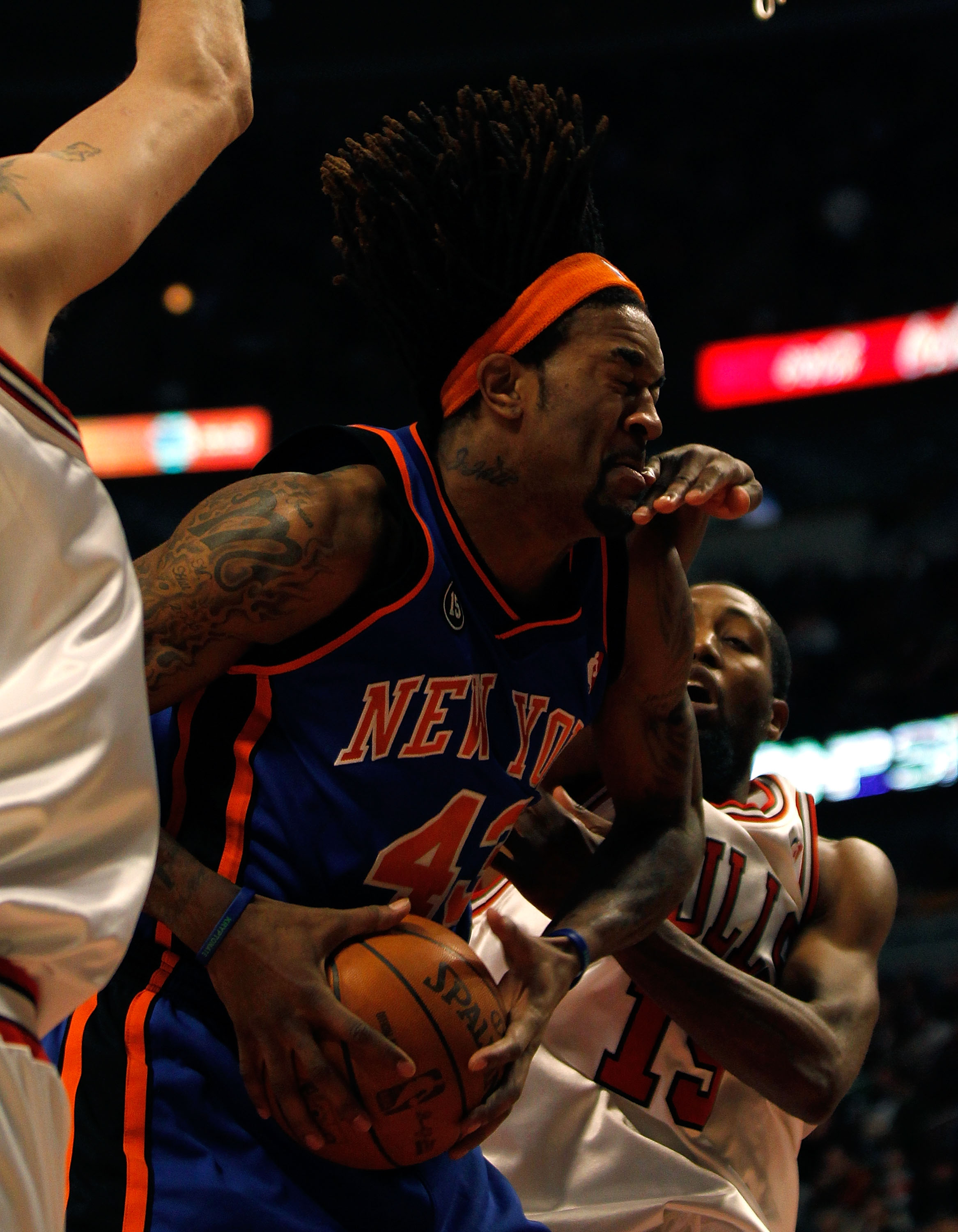 CHICAGO - FEBRUARY 16: John Salmons #15 of the Chicago Bulls gets his hand in the face of Jordan Hill #43 of the New York Knicks as hill tries to shoot at the United Center on February 16, 2010 in Chicago, Illinois. NOTE TO USER: User expressly acknowledg