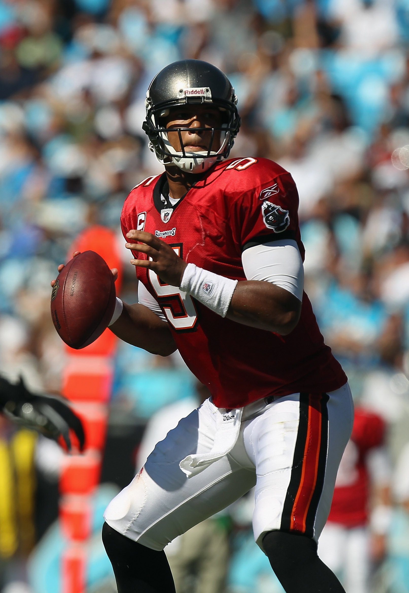 CHARLOTTE, NC - SEPTEMBER 19:  Josh Freeman #5 of the Tampa Bay Buccaneers throws a pass against the Carolina Panthers during their game at Bank of America Stadium on September 19, 2010 in Charlotte, North Carolina.  (Photo by Streeter Lecka/Getty Images)