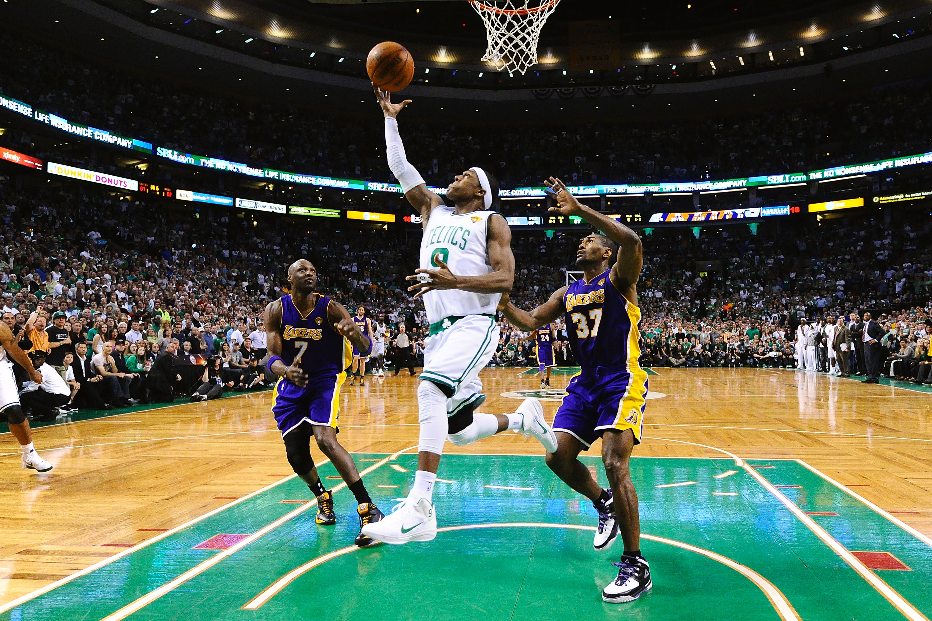 BOSTON - JUNE 13:  Rajon Rondo #9 of the Boston Celtics goes to the basket against Lamar Odom #7 and Ron Artest #37 of the Los Angeles Lakers during Game Five of the 2010 NBA Finals on June 13, 2010 at TD Garden in Boston, Massachusetts. NOTE TO USER: Use