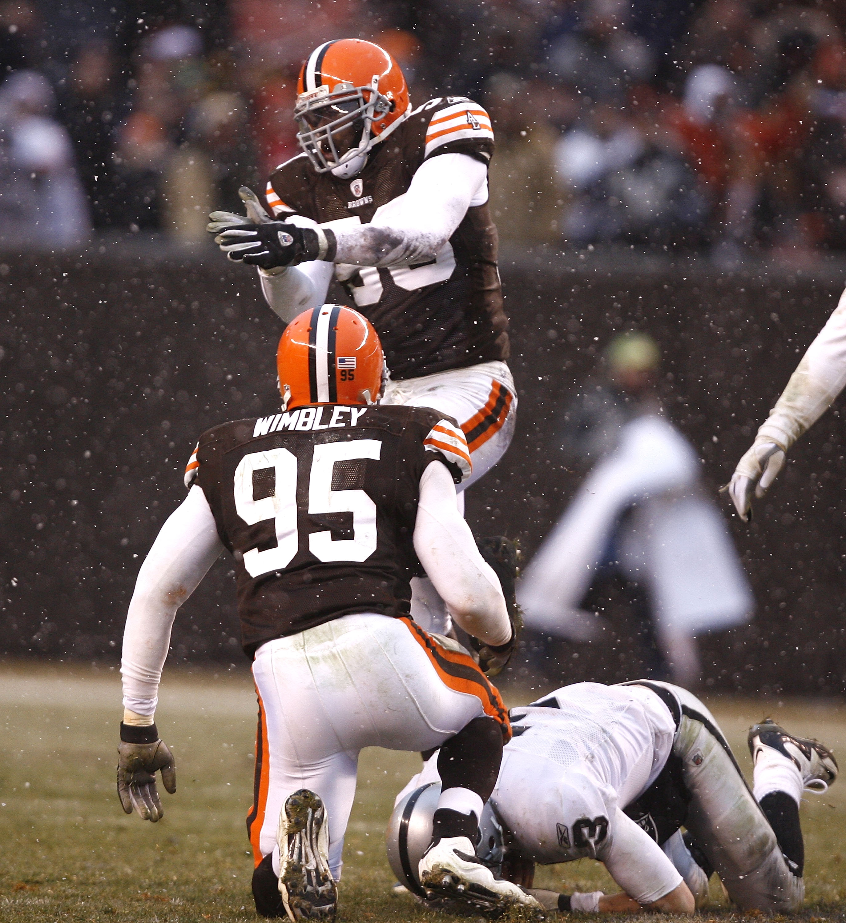 CLEVELAND - DECEMBER 27:  Marcus Benard #58 and Kamerion Wimbley #95 of the Cleveland Browns celebrate after sacking Charlie Frye #3 of the Oakland Raiders at Cleveland Browns Stadium on December 27, 2009 in Cleveland, Ohio.  (Photo by Matt Sullivan/Getty