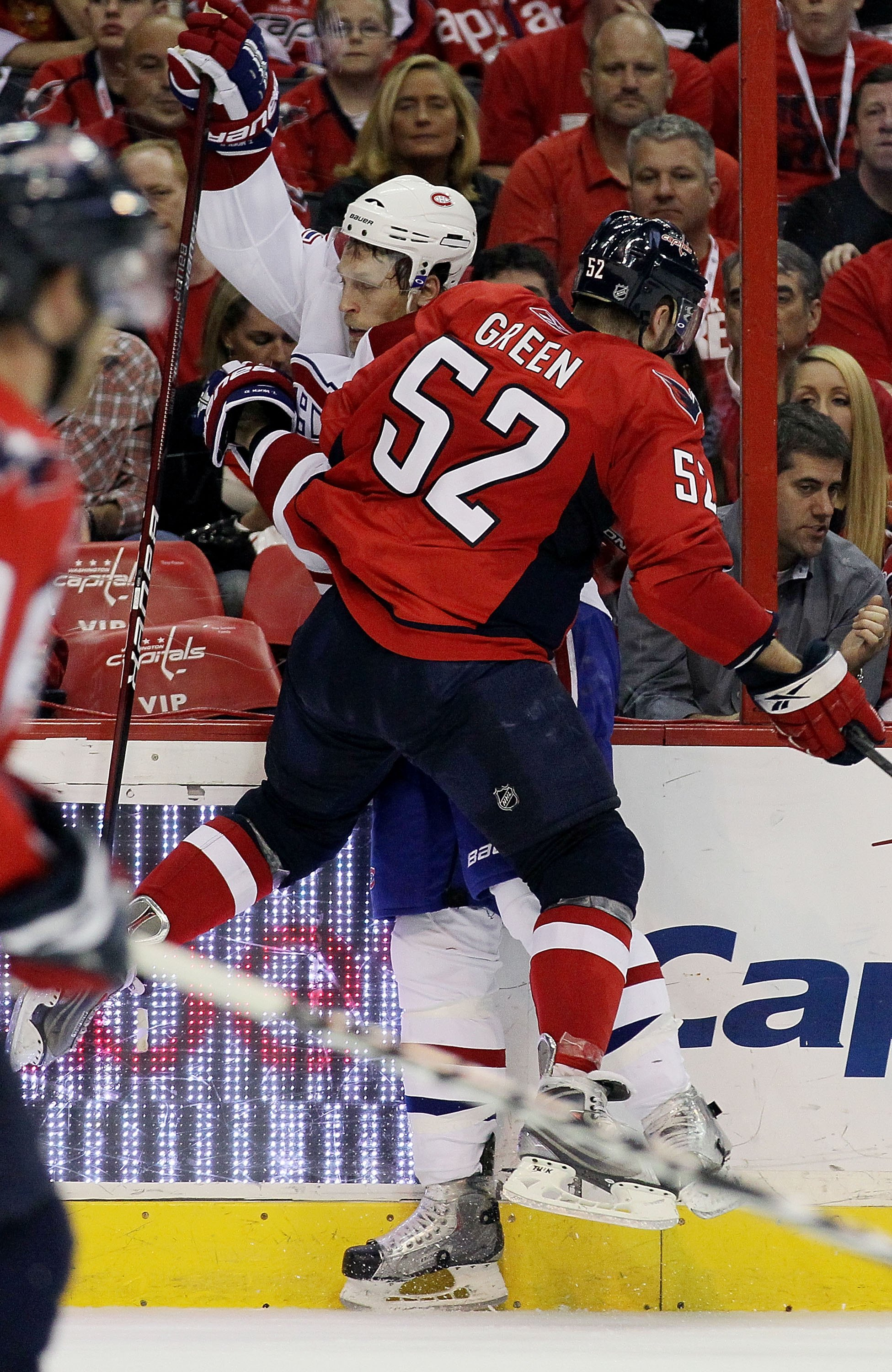 WASHINGTON DC, DC - APRIL 23:  Mike Green #52 of the Washington Capitals checks Travis Moen #32 of the Montreal Canadiens in Game Five of the Eastern Conference Quarterfinals during the 2010 NHL Stanley Cup Playoffs at the Verizon Center on April 23, 2010