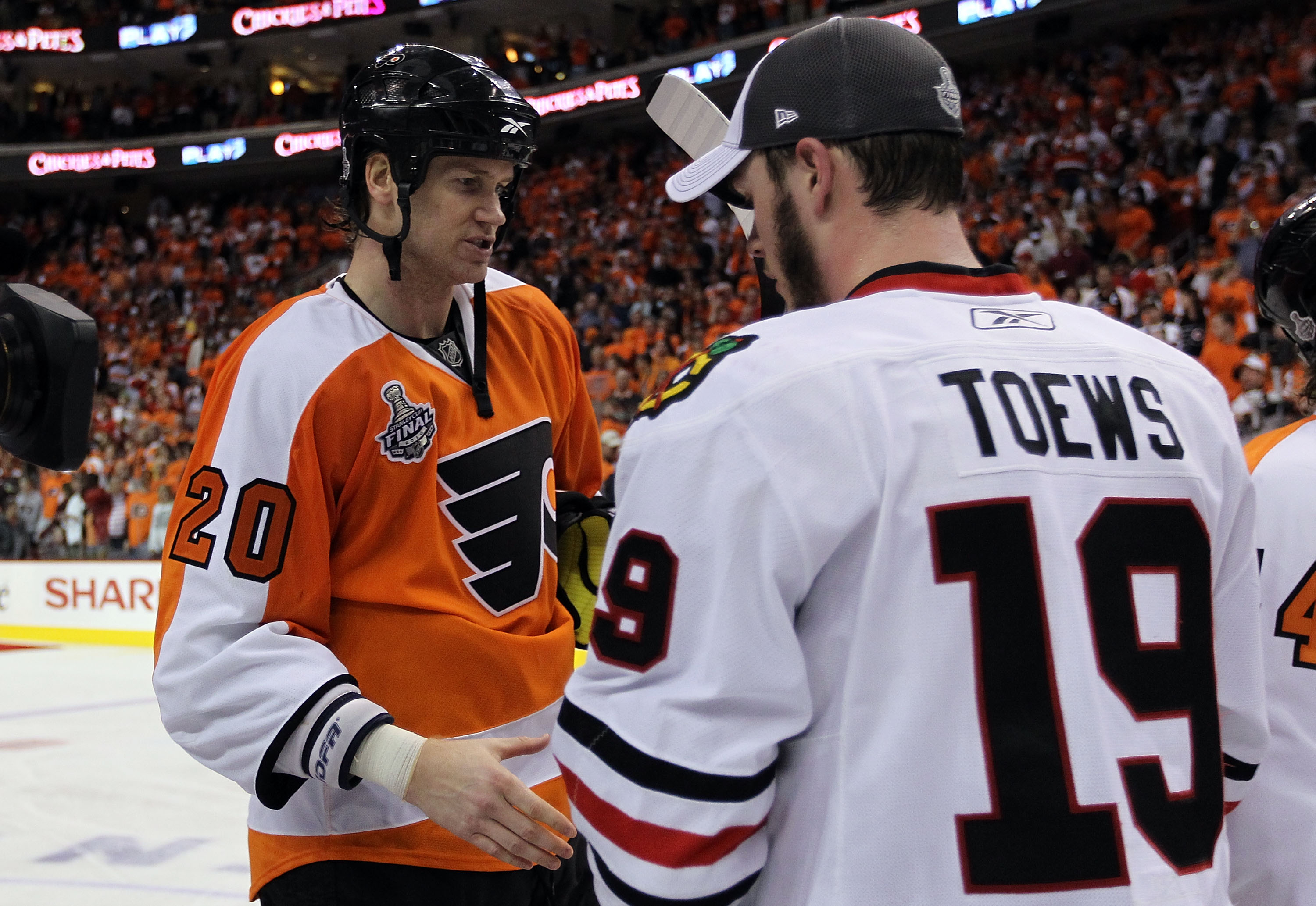 PHILADELPHIA - JUNE 09:  Jonathan Toews #19 of the Chicago Blackhawks shakes hands with Chris Pronger #20 of the Philadelphia Flyers after the Blackhawks defeated the Philadelphia Flyers 4-3 to win the Stanley Cup in Game Six of the 2010 NHL Stanley Cup F