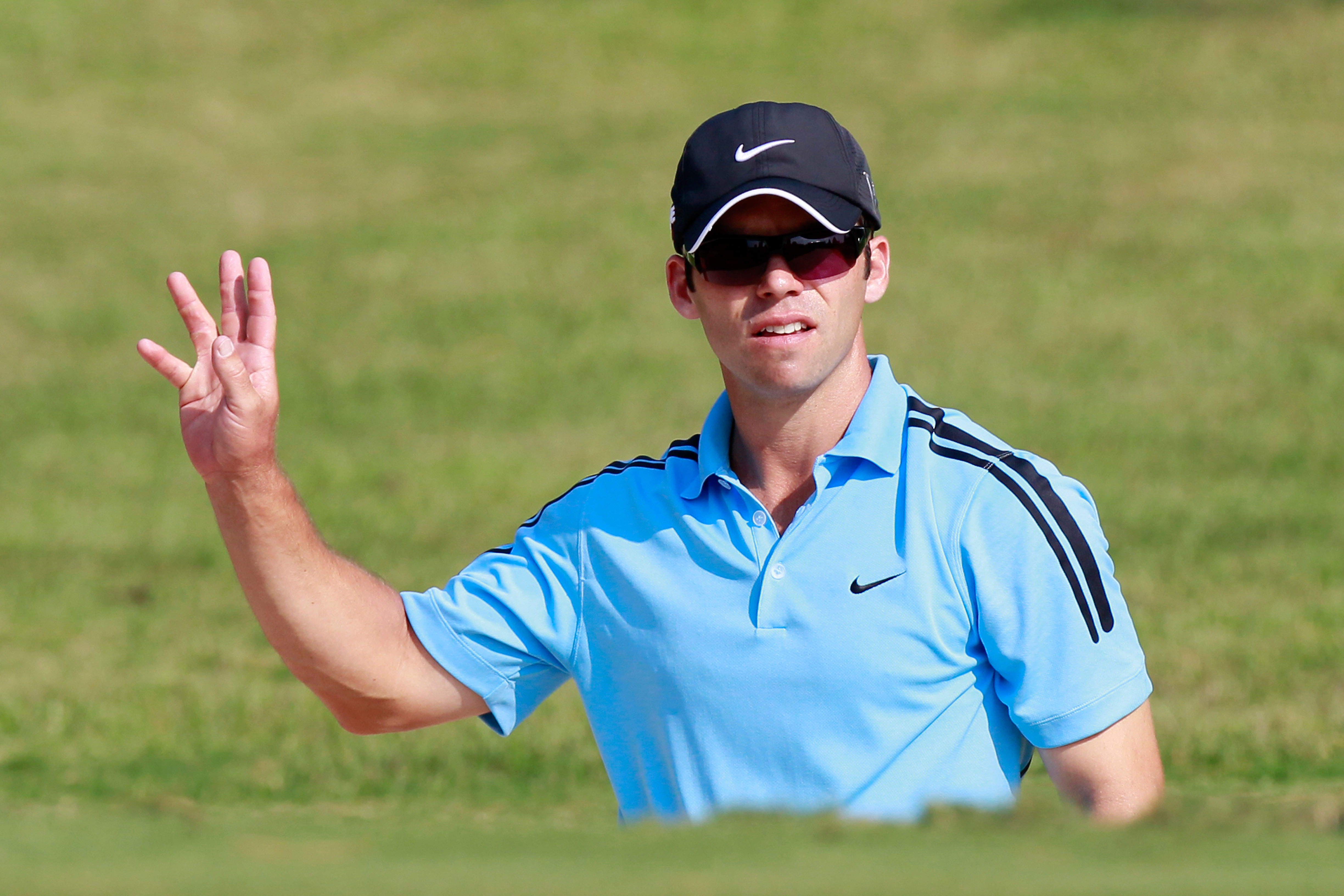 ATLANTA - SEPTEMBER 23:  Paul Casey of England reacts after his sand shot on the 14th green during the first round of THE TOUR Championship presented by Coca-Cola at East Lake Golf Club on September 23, 2010 in Atlanta, Georgia.  (Photo by Kevin C. Cox/Ge