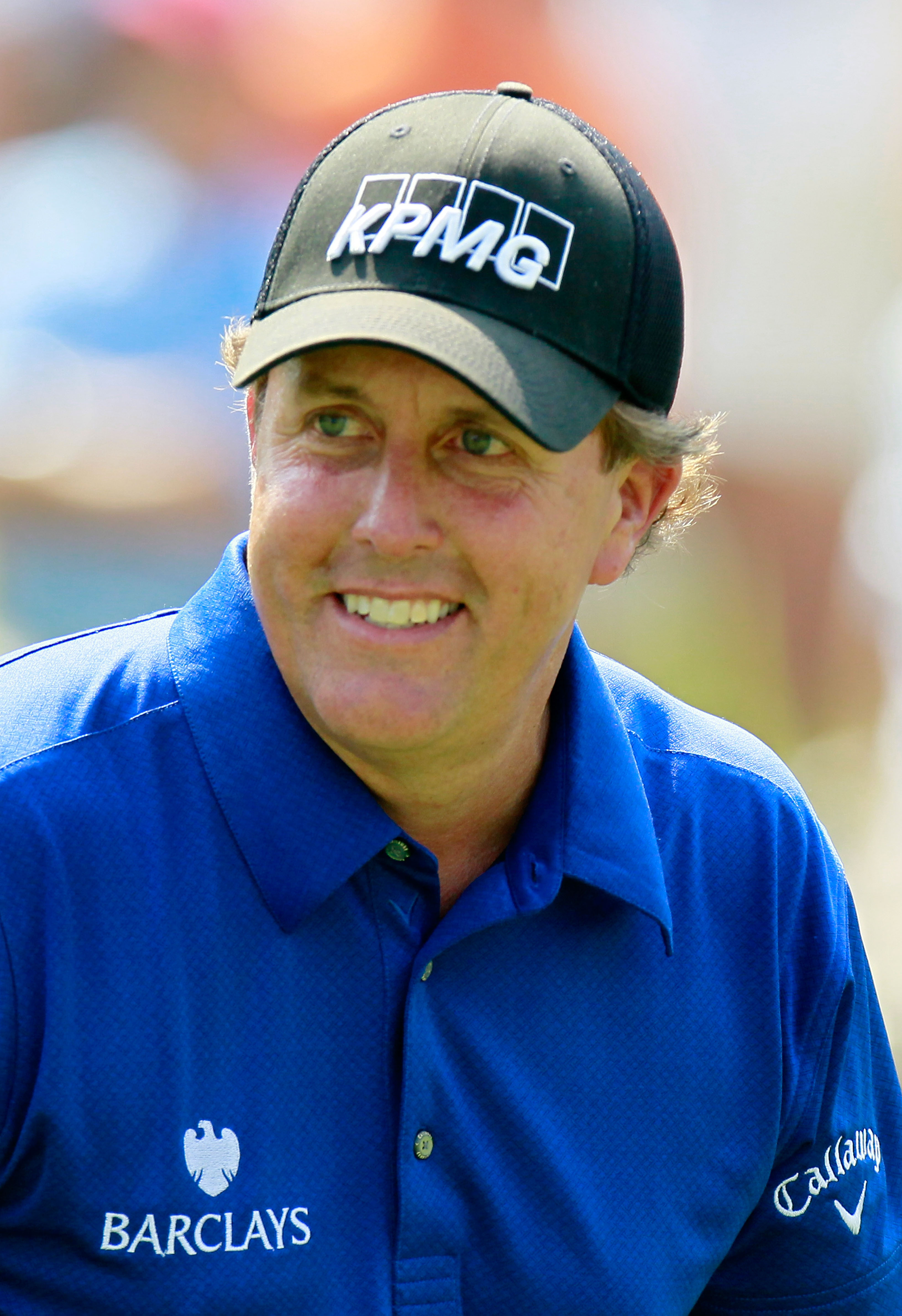 ATLANTA - SEPTEMBER 23:  Phil Mickelson smiles as he walks off the eighth tee during the first round of THE TOUR Championship presented by Coca-Cola at East Lake Golf Club on September 23, 2010 in Atlanta, Georgia.  (Photo by Kevin C. Cox/Getty Images)