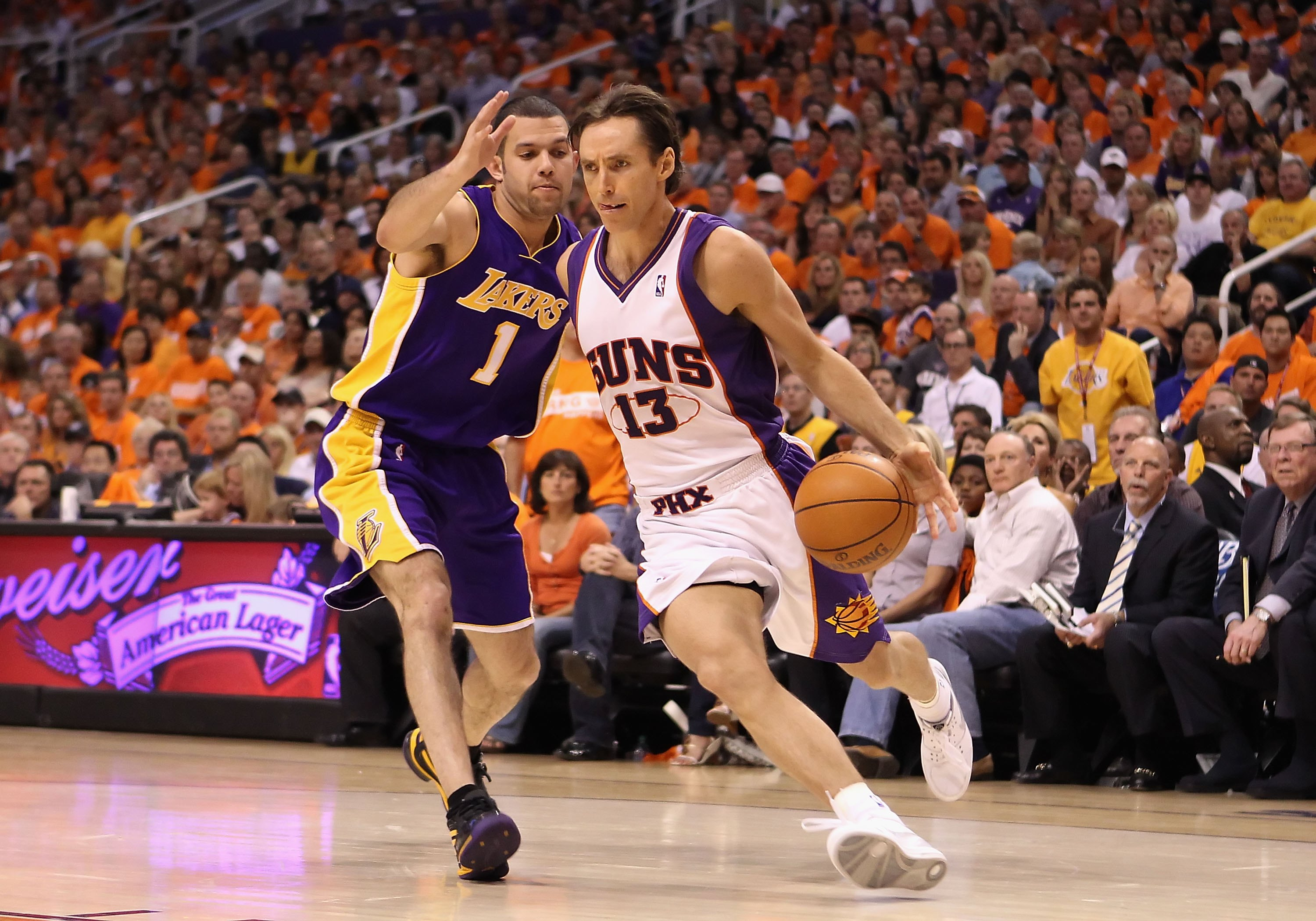 PHOENIX - MAY 23:  Steve Nash #13 of the Phoenix Suns handles the ball under pressure from Jordan Farmar #1 of the Los Angeles Lakers during Game Three of the Western Conference finals of the 2010 NBA Playoffs at US Airways Center on May 23, 2010 in Phoen