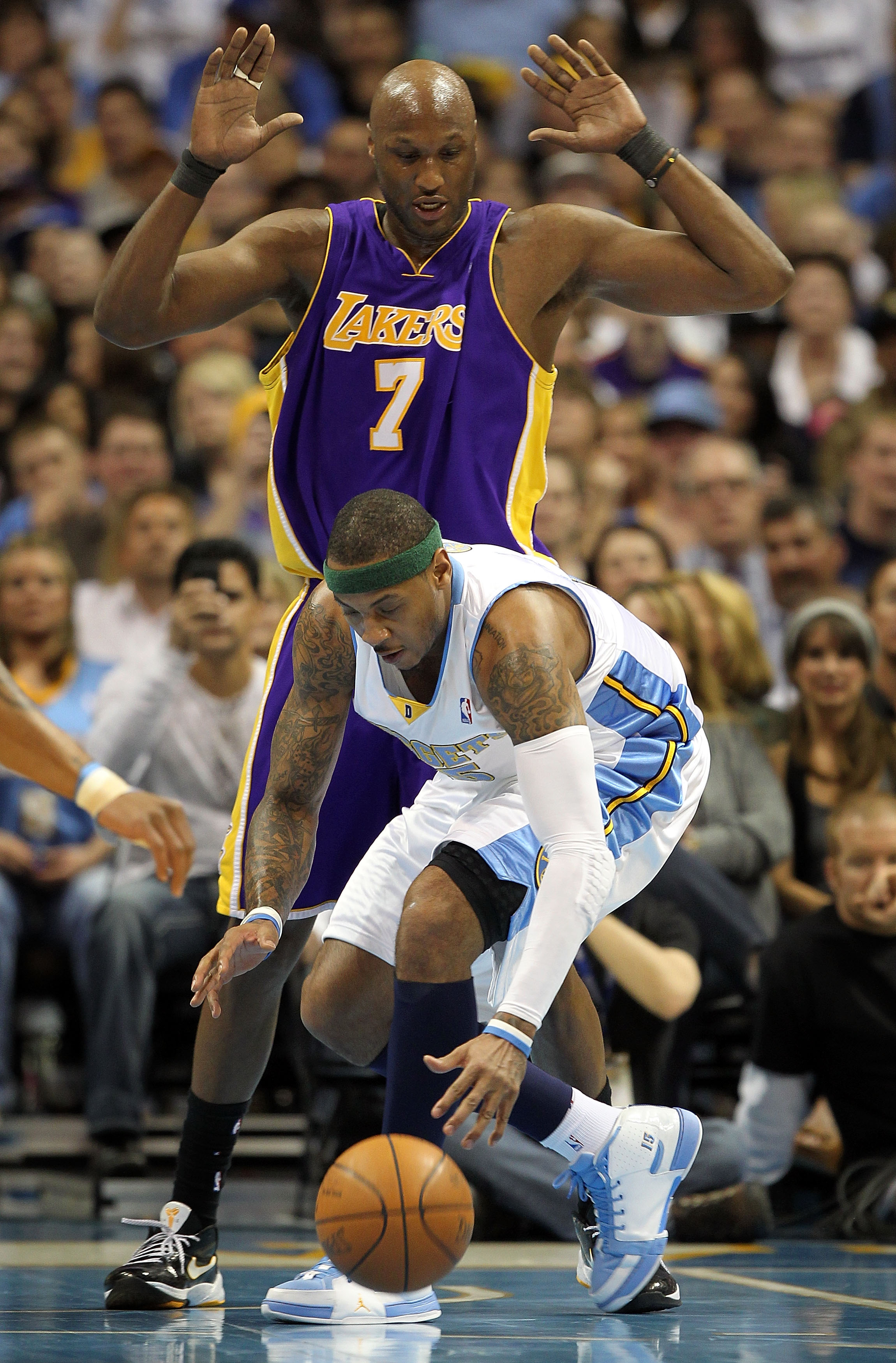 DENVER - APRIL 08:  Carmelo Anthony #15 of the Denver Nuggets collects the ball as Lamar Odom #7 of the Los Angeles Lakers defends during NBA action at the Pepsi Center on April 8, 2010 in Denver, Colorado. NOTE TO USER: User expressly acknowledges and ag
