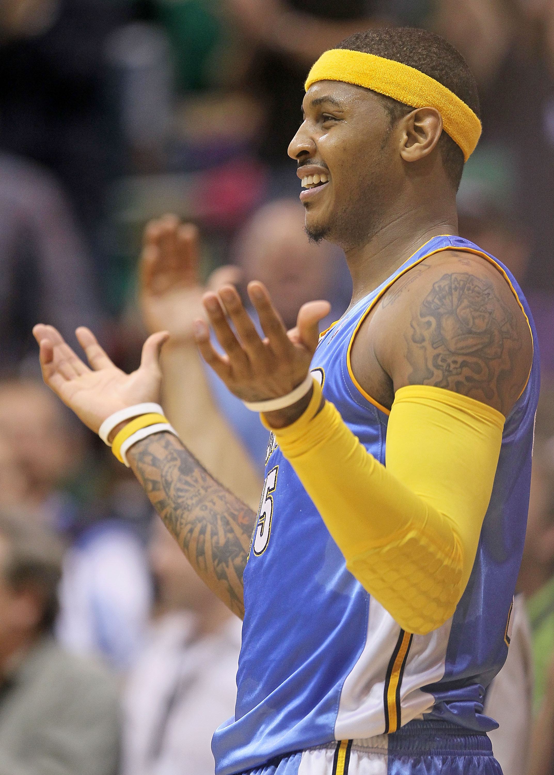 SALT LAKE CITY - APRIL 25:  Carmelo Anthony #15 of the Denver Nuggets protests after being called for his third foul against the Utah Jazz during  Game Four of the Western Conference Quarterfinals of the 2010 NBA Playoffs at EnergySolutions Arena on April