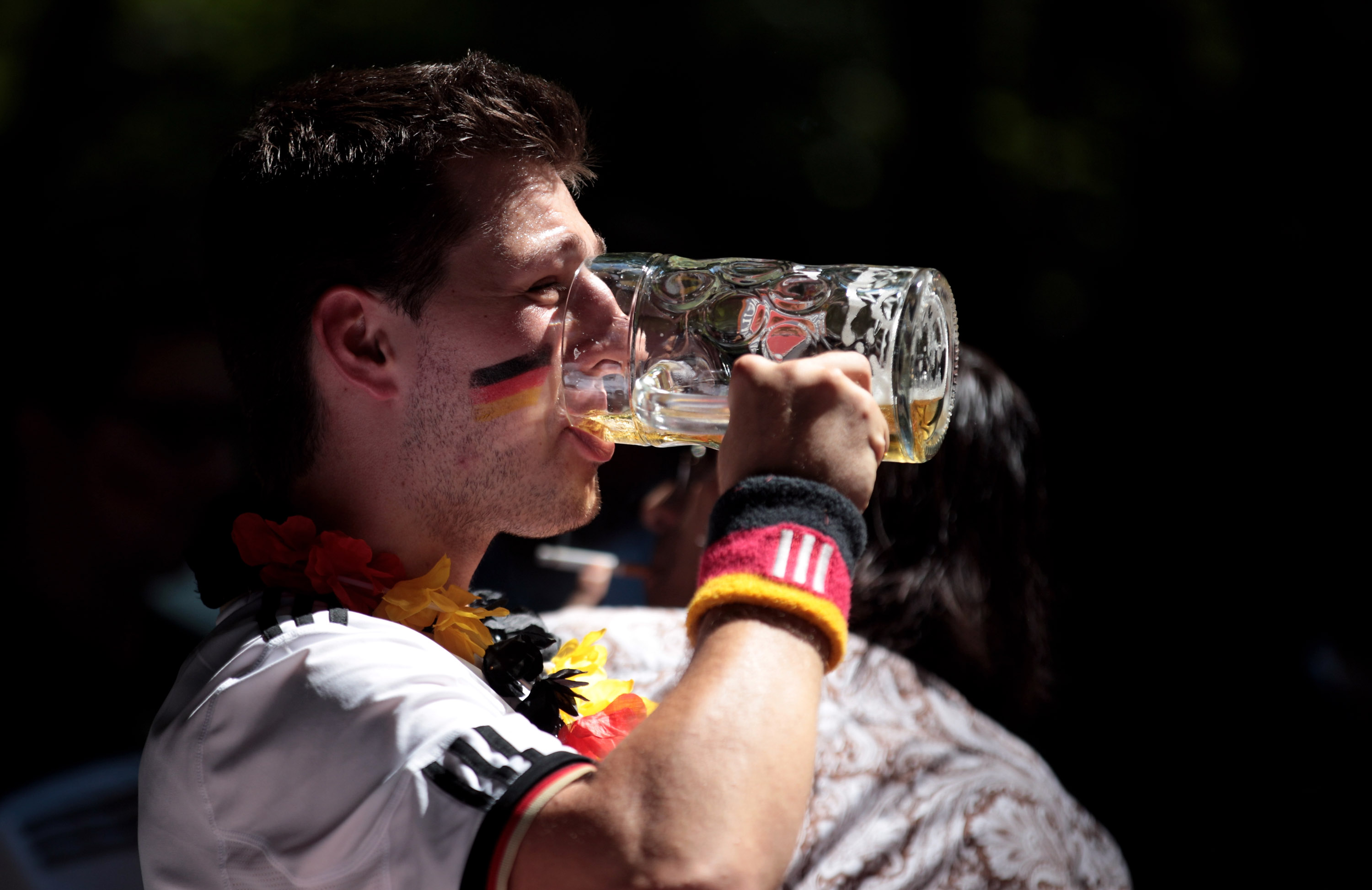 MUNICH - JULY 03:  A supporter of the German football team drinks a beer as he watches the 2010 FIFA World Cup quarter final match between Germany and Argentina at a beer garden on July 3, 2010 in Munich, Germany.  (Photo by Miguel Villagran/Getty Images)