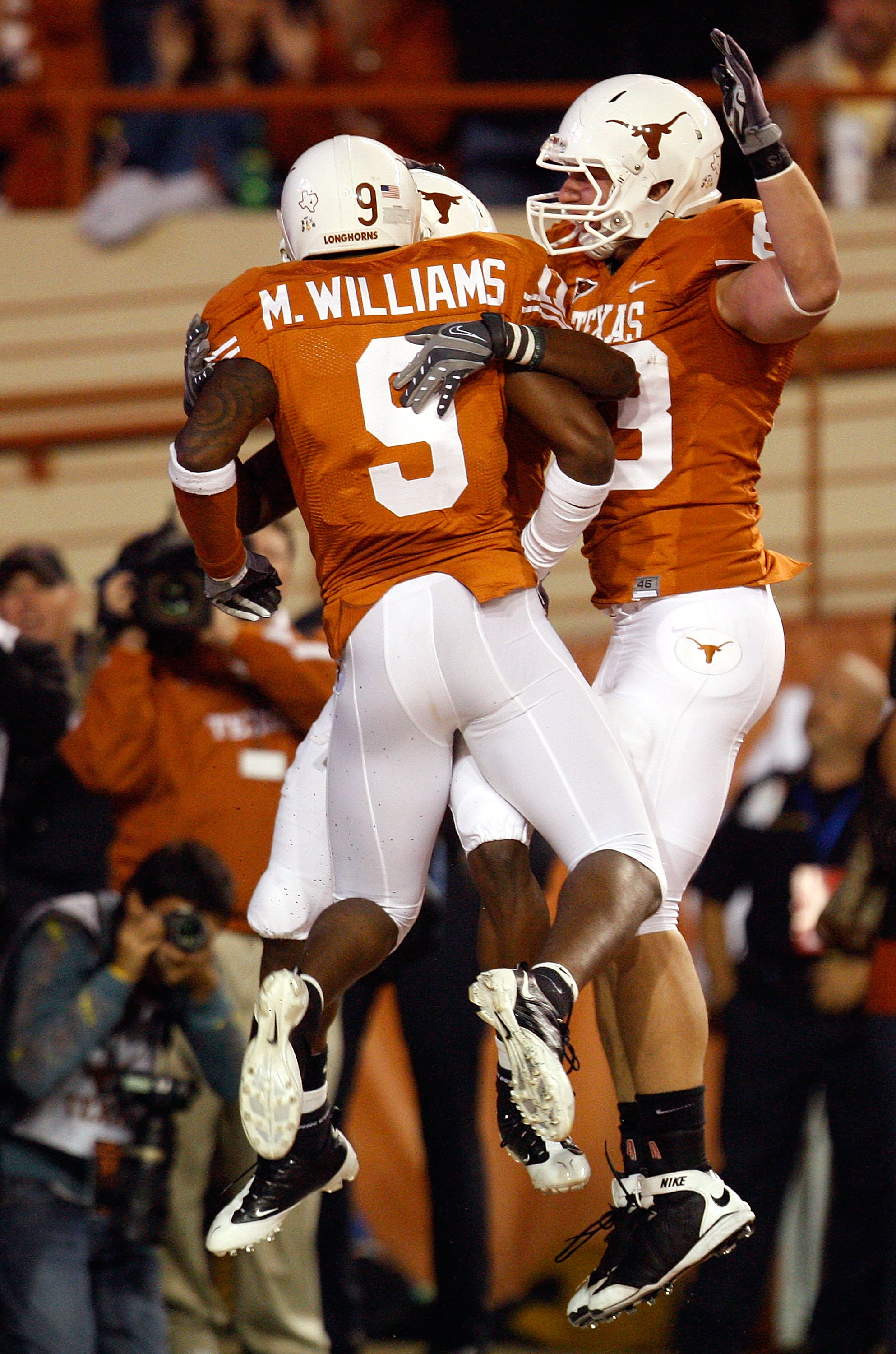AUSTIN, TX - NOVEMBER 21:  Wide receiver James Kirkendoll #11 of the Texas Longhorns celebrates his touchdown with Malcolm Williams #9 and Greg Smith #83 at Darrell K Royal-Texas Memorial Stadium on November 21, 2009 in Austin, Texas.  (Photo by Ronald Ma