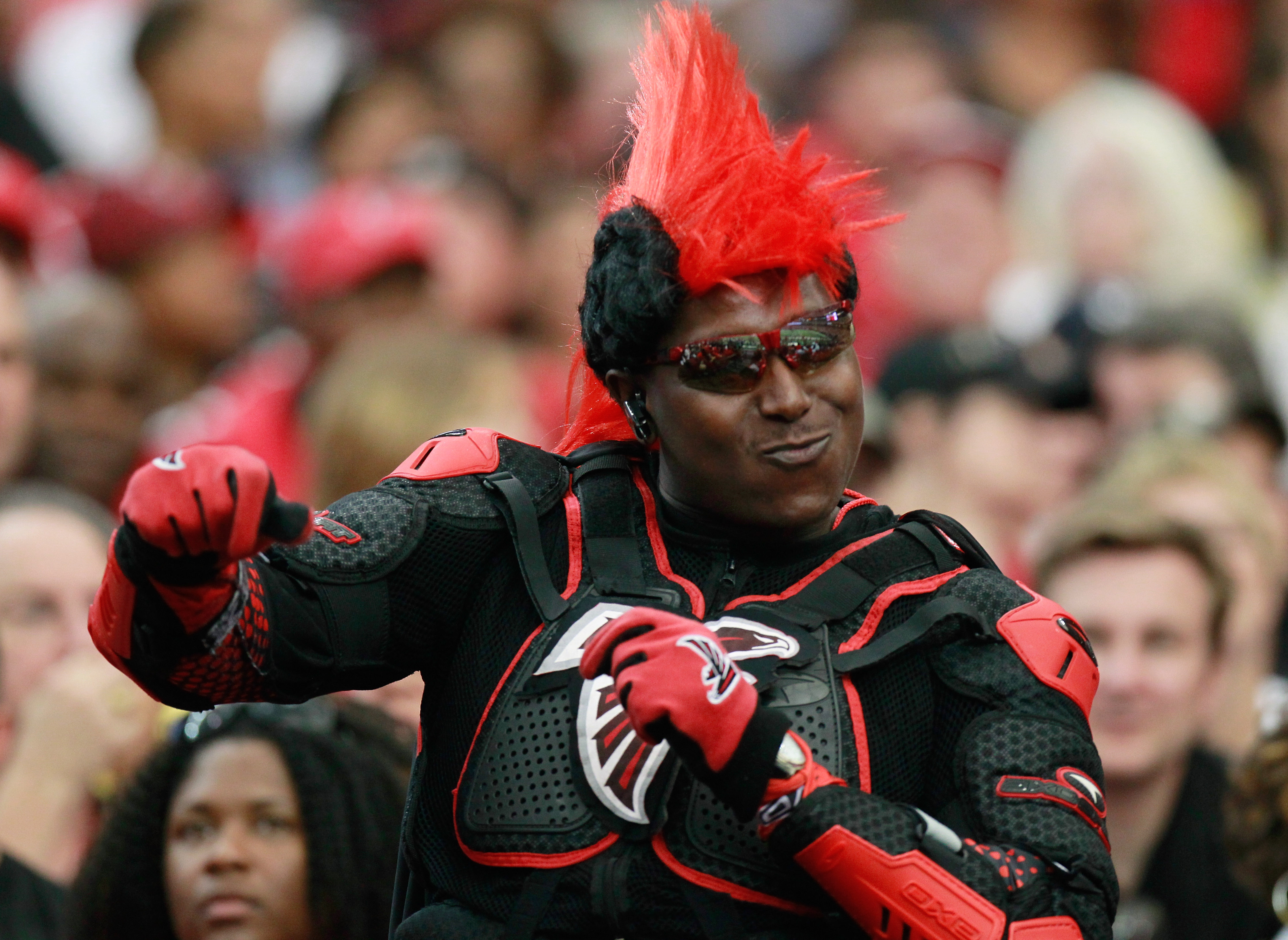 ATLANTA - SEPTEMBER 19:  A fan of the Atlanta Falcons cheers during the game against the Arizona Cardinals at Georgia Dome on September 19, 2010 in Atlanta, Georgia.  (Photo by Kevin C. Cox/Getty Images)