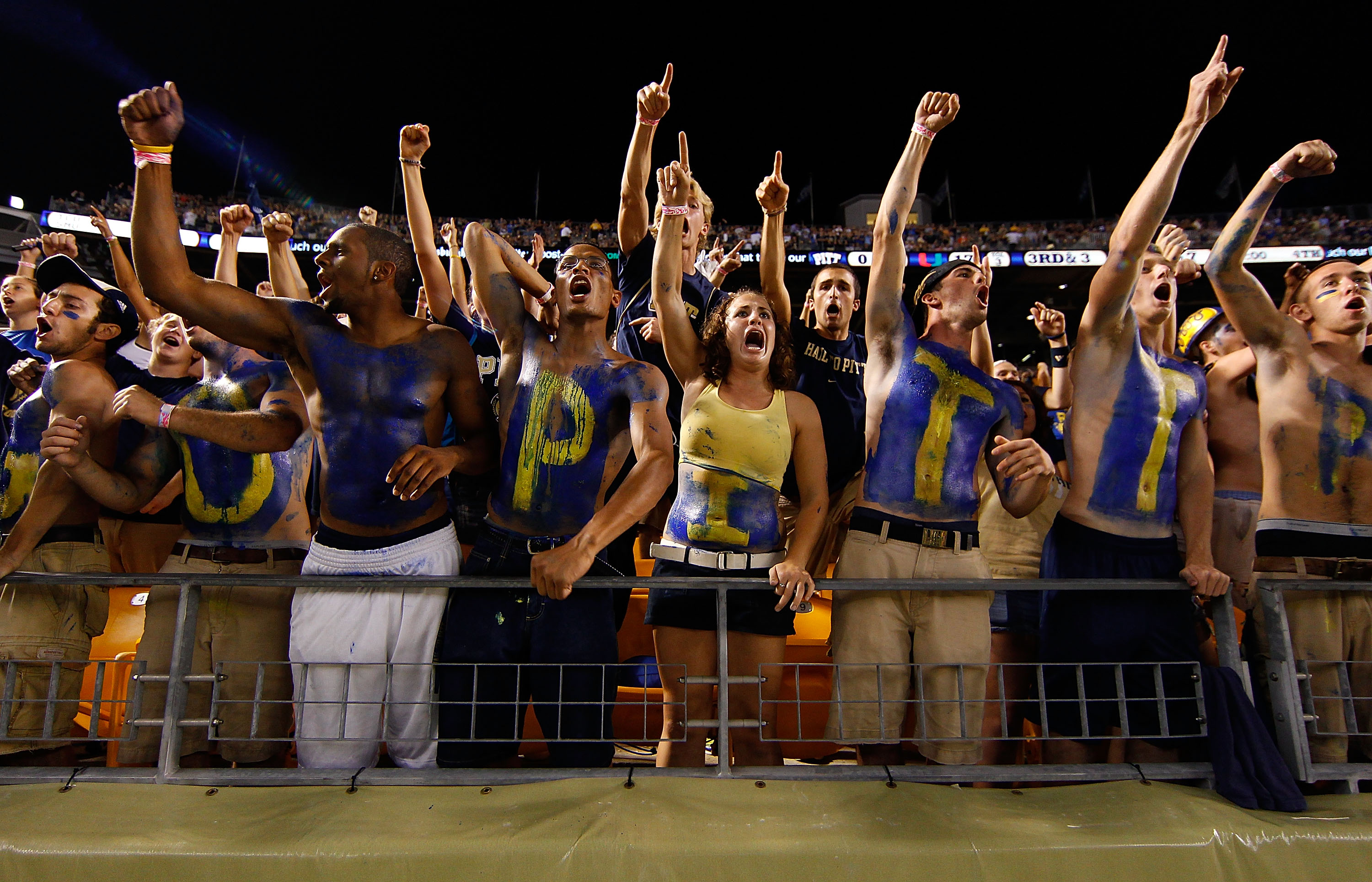 PITTSBURGH - SEPTEMBER 23:  University of Pittsburgh fans cheer during the game against the Miami Hurricanes on September 23, 2010 at Heinz Field in Pittsburgh, Pennsylvania.  (Photo by Jared Wickerham/Getty Images)