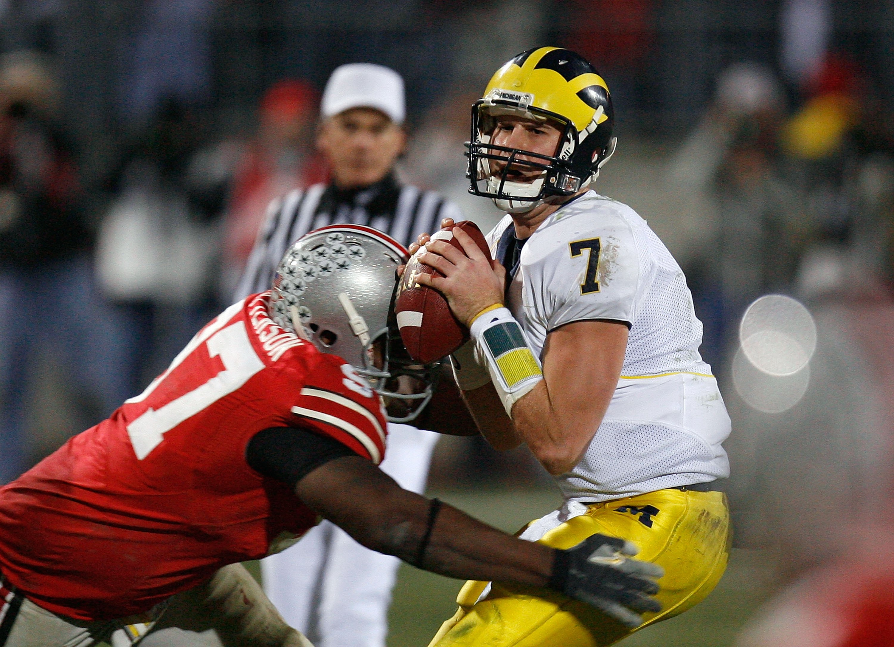 COLUMBUS, OH - NOVEMBER 18:  David Patterson #97 of the Ohio State Buckeyes hits quarterback Chad Henne #7 of the Michigan Wolverines November 18, 2006 at Ohio Stadium in Columbus, Ohio. Ohio State won 42-39.  (Photo by Gregory Shamus/Getty Images)