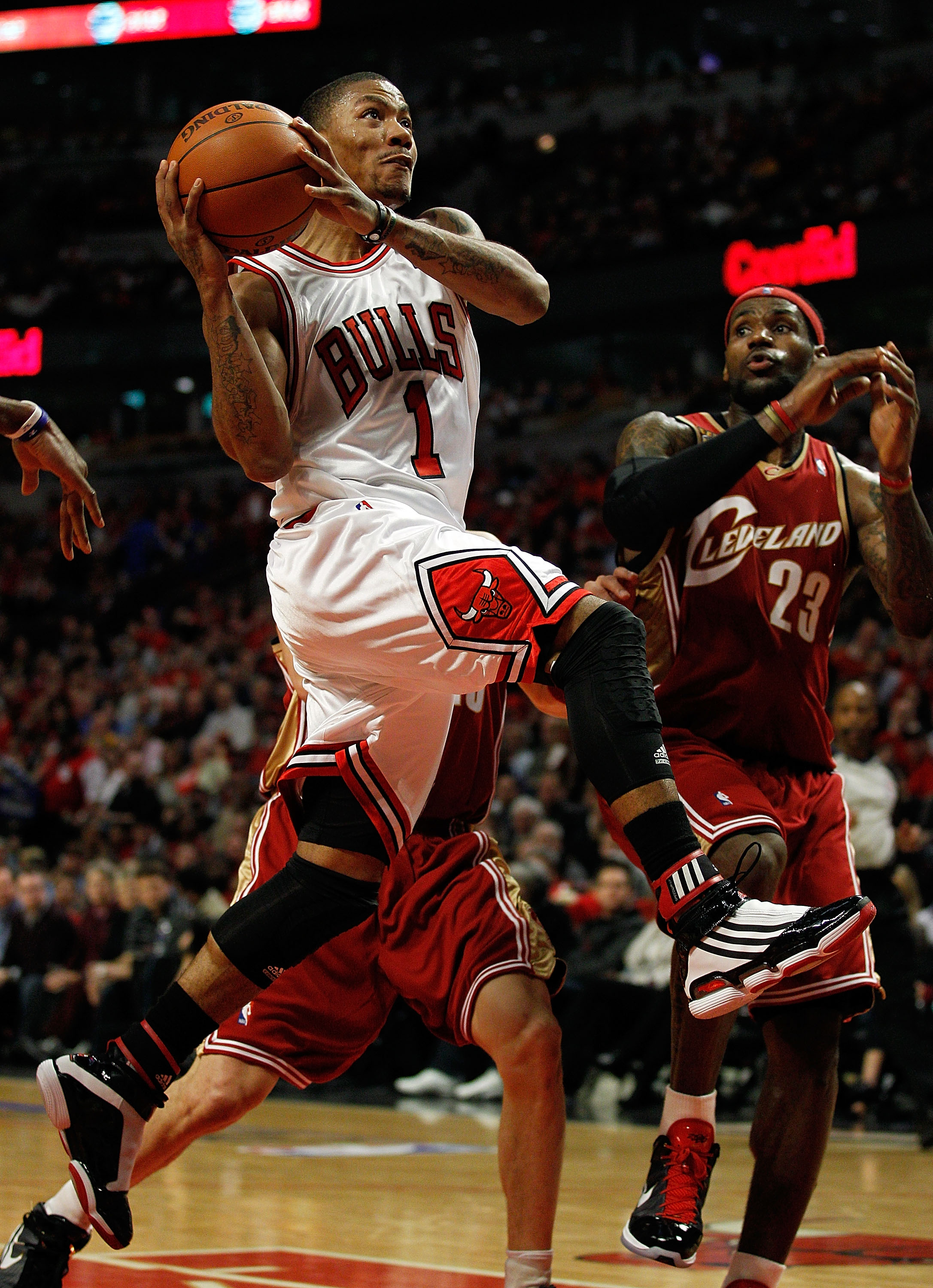 CHICAGO - APRIL 25: Derrick Rose #1 of the Chicago Bulls drives to the basket past LeBron James #23 of the Cleveland Cavaliers in Game Four of the Eastern Conference Quarterfinals during the 2010 NBA Playoffs at the United Center on April 25, 2010 in Chic